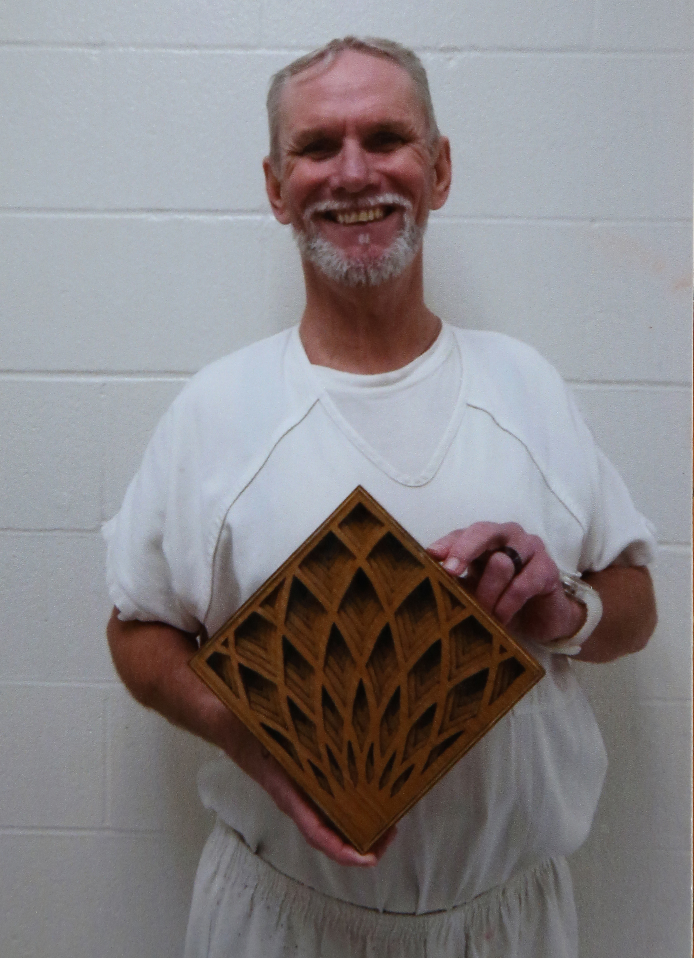 Dennis Perry passes time learning new skills in prison.