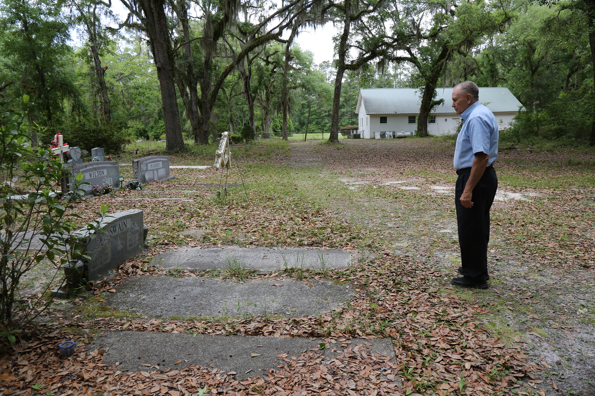 Butch Kennedy visits the graves, again.