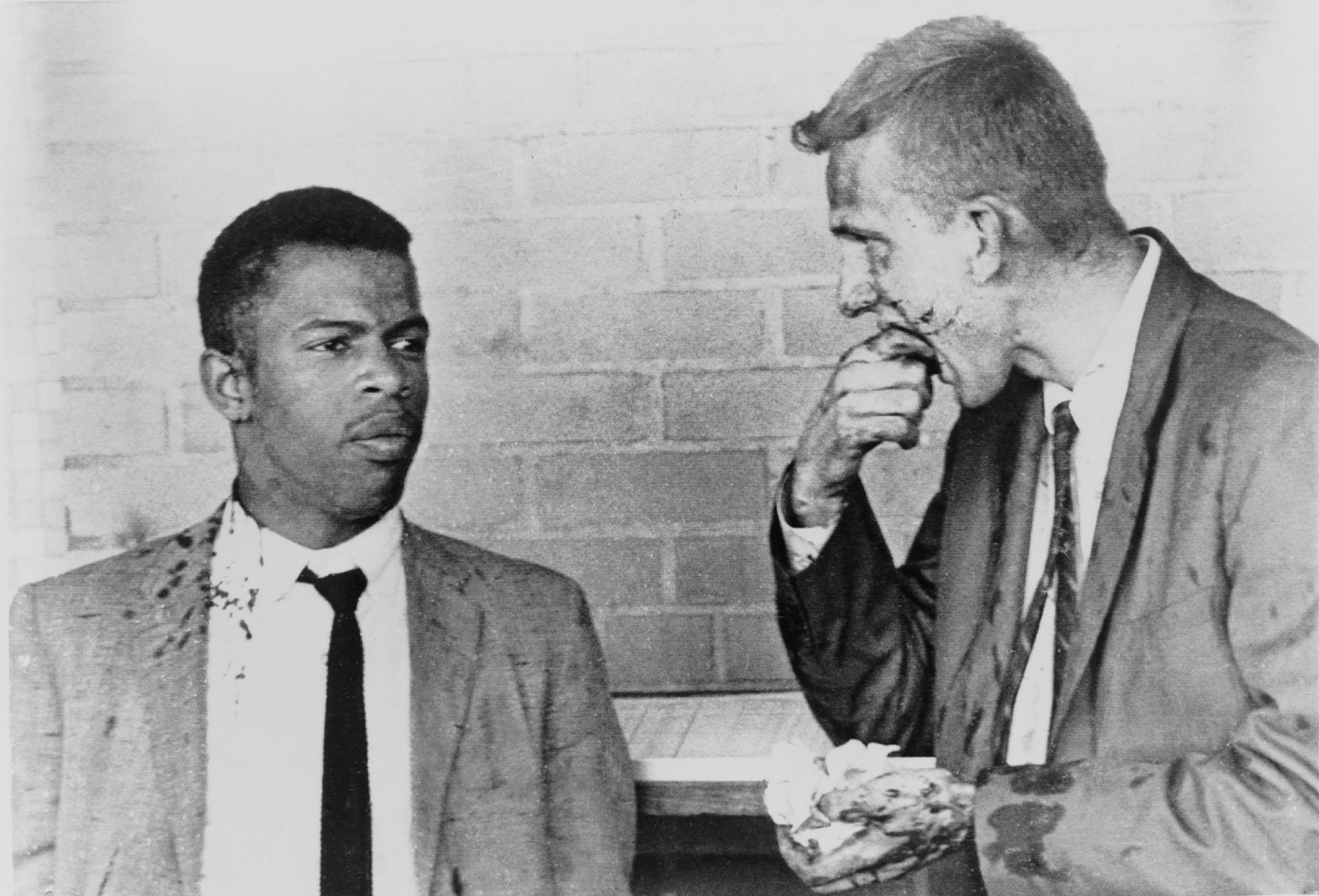 John Lewis and fellow Freedom Rider James Zwerg collect themselves after surviving a bloody attack at a bus station in Montgomery, Ala. in 1961.