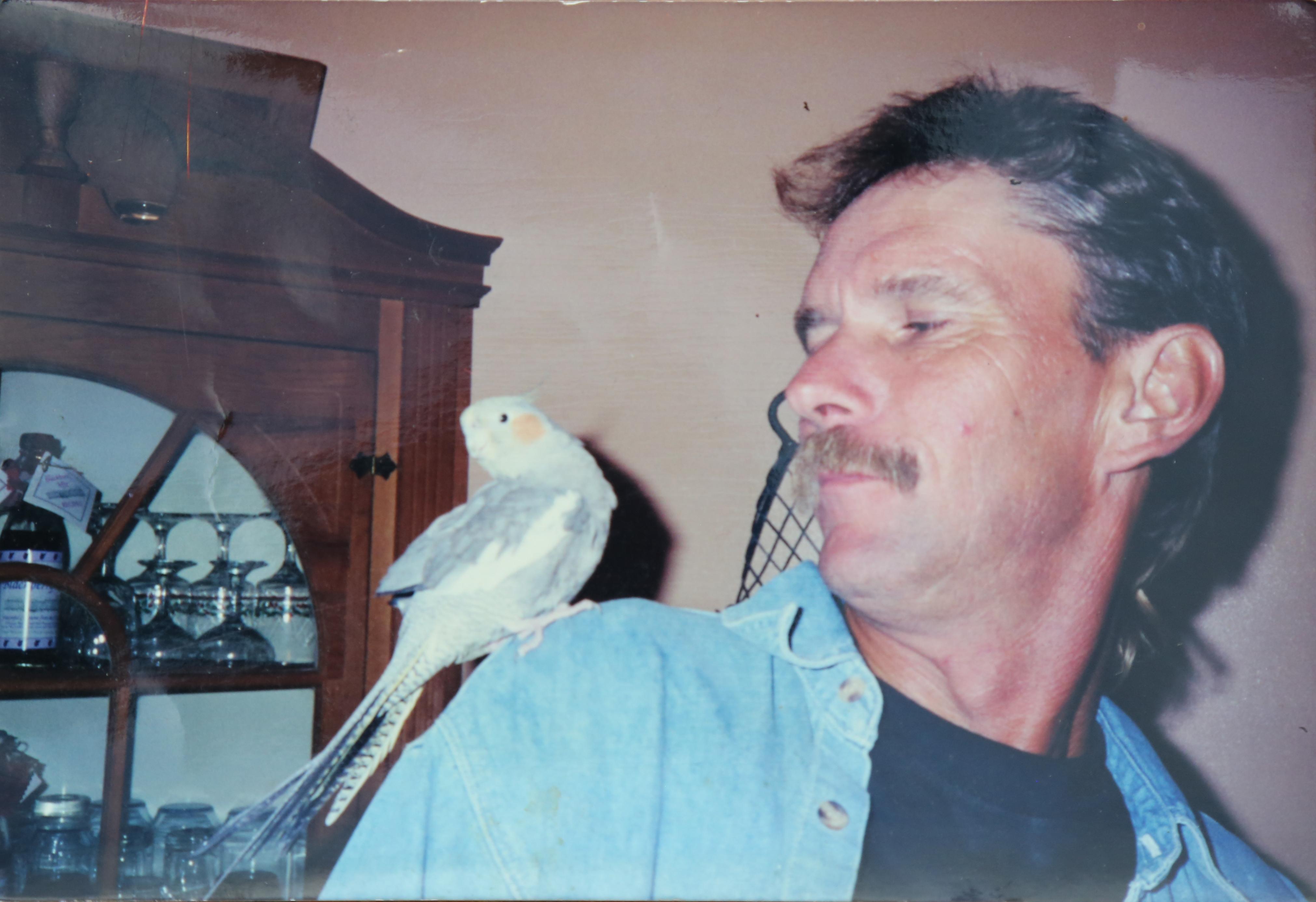 Dennis Perry's pet cockatiel was named Squeaky.