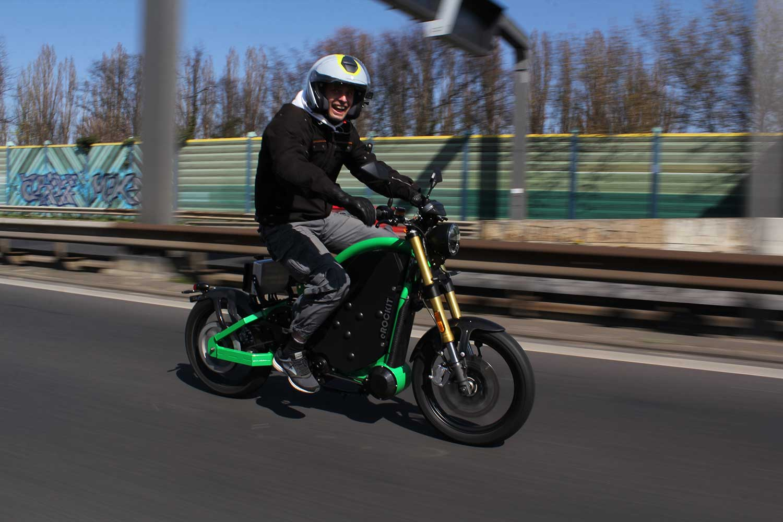 Watch a stunt athlete hit the autobahn (hard) on a bike