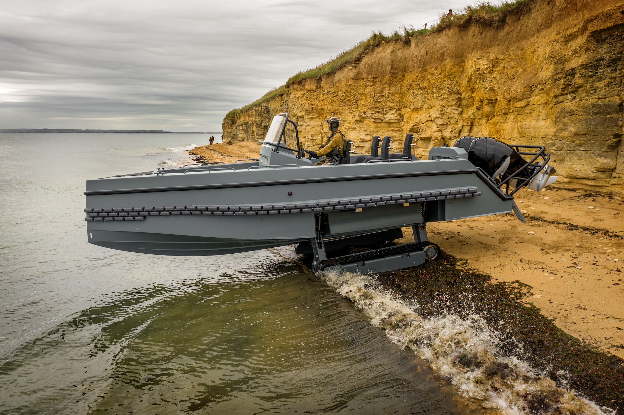 This military speedboat moves from water to land without wheels