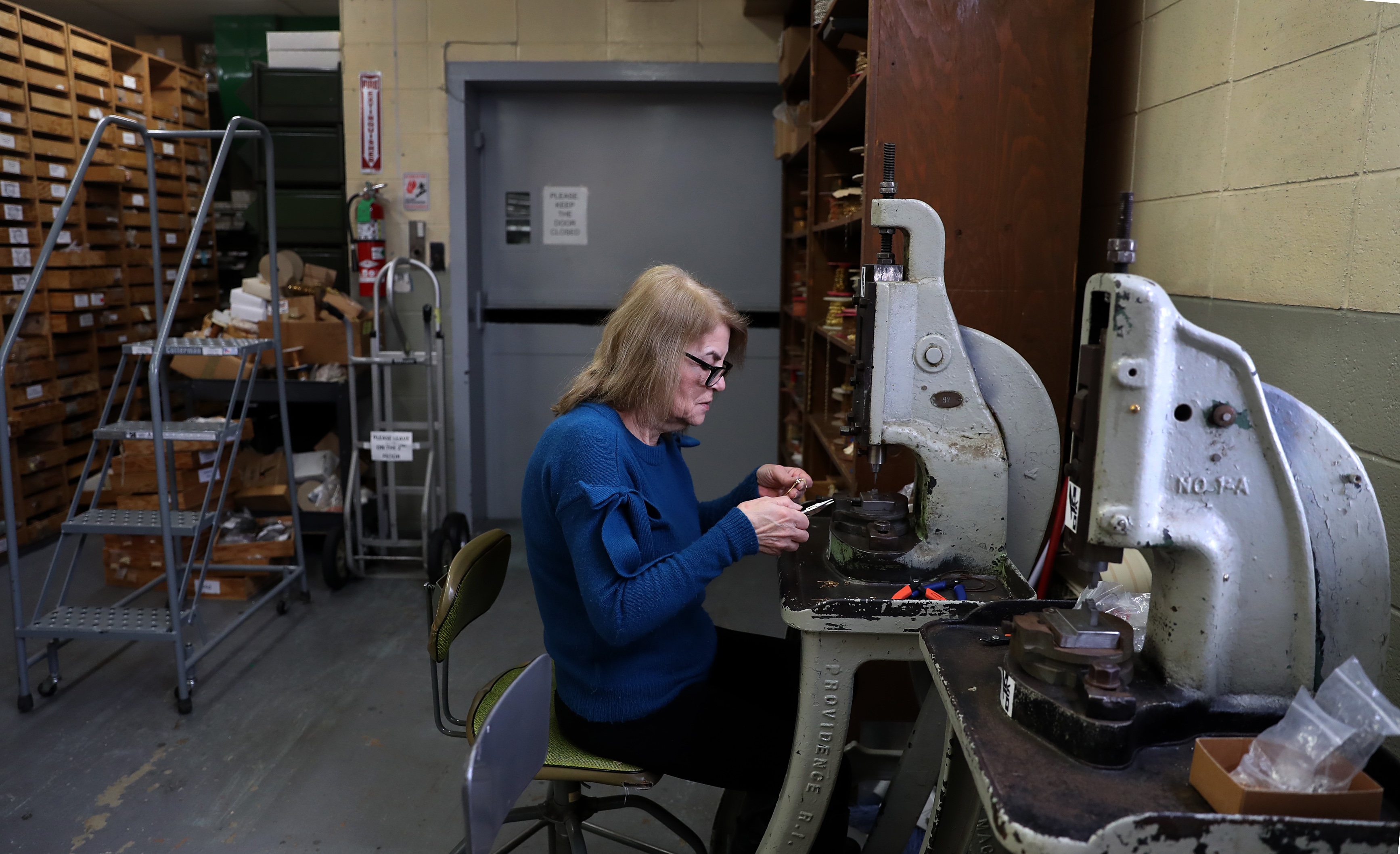 Virginia Gasparian, an employee, uses a foot press to make jewelry at Air & Anchor in Cranston, Rhode Island.