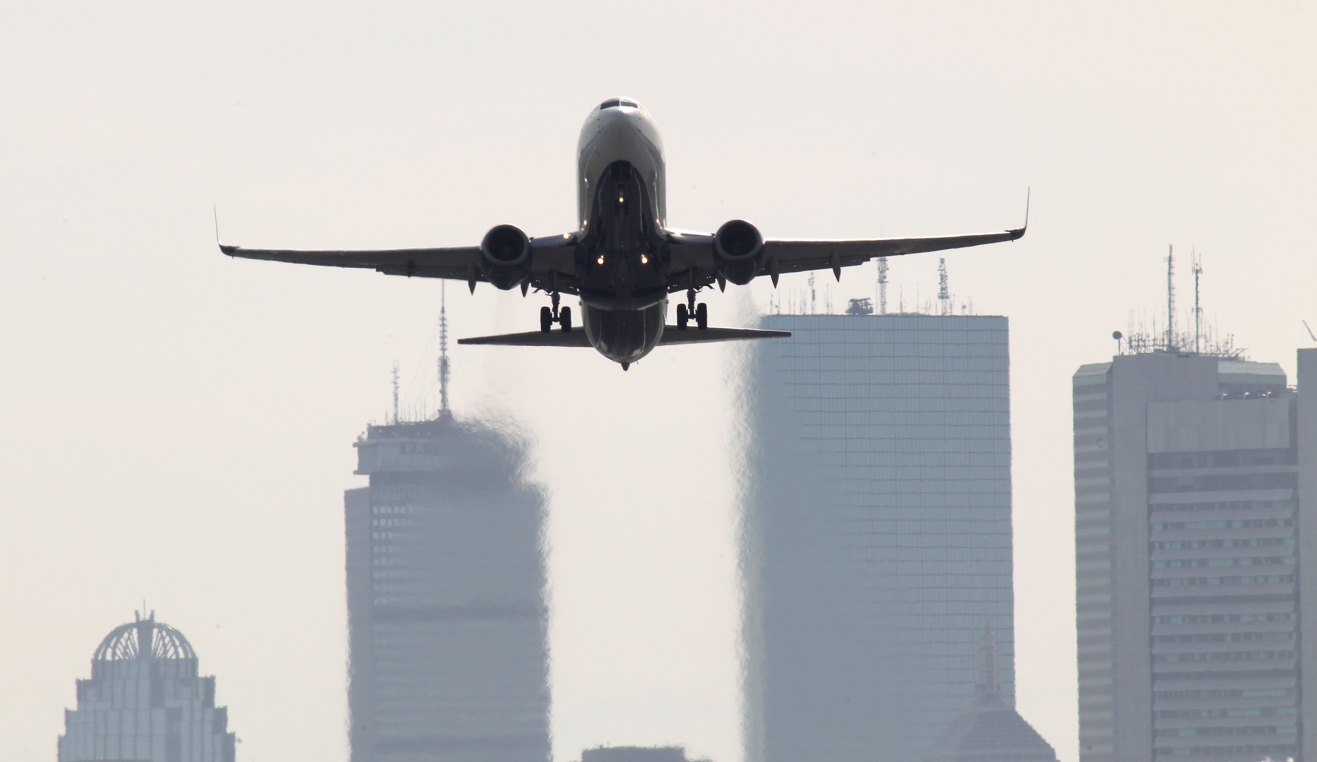 A plane takes off from Logan Airport.