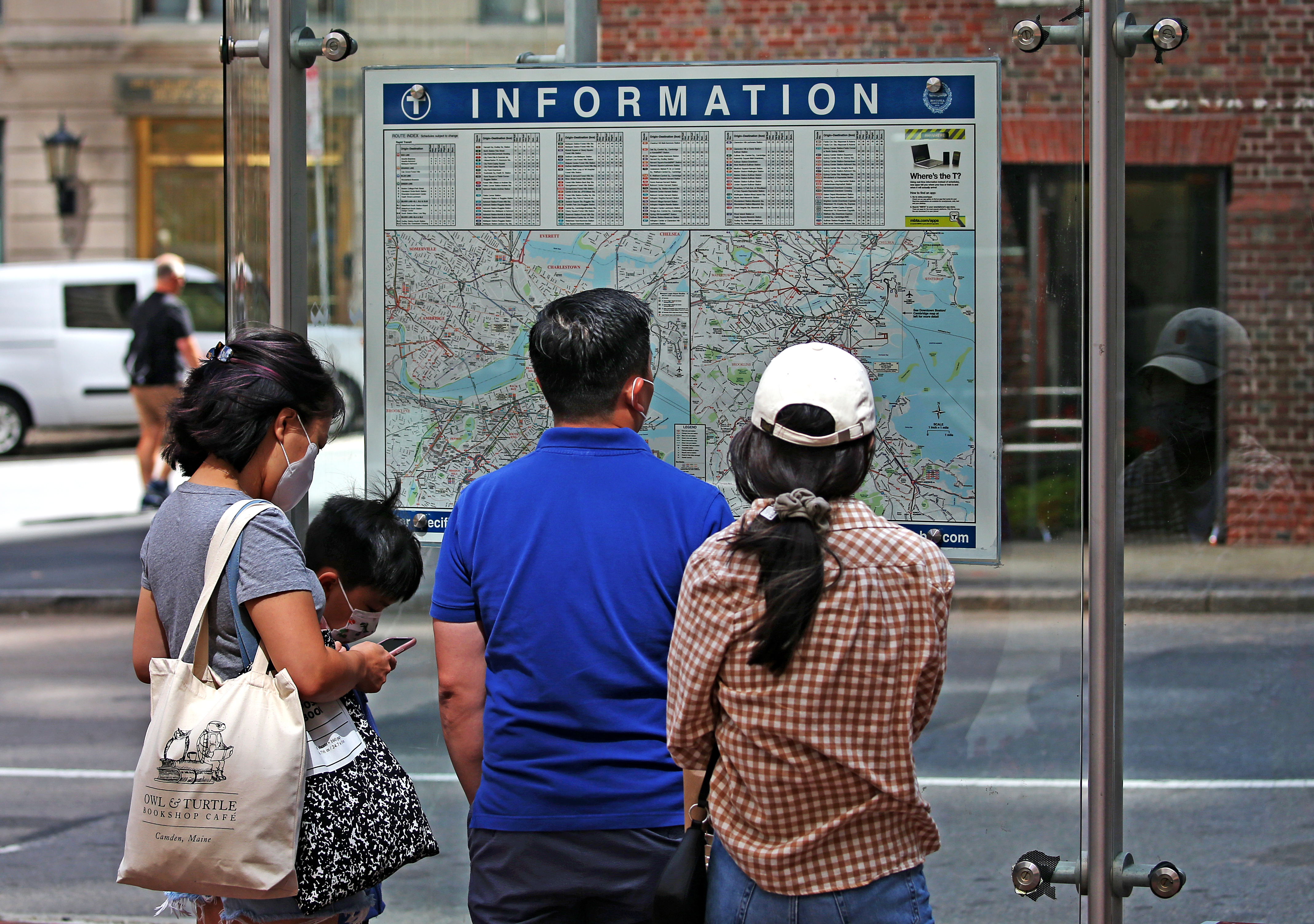Tourists used a map to navigate around Boston from State street.