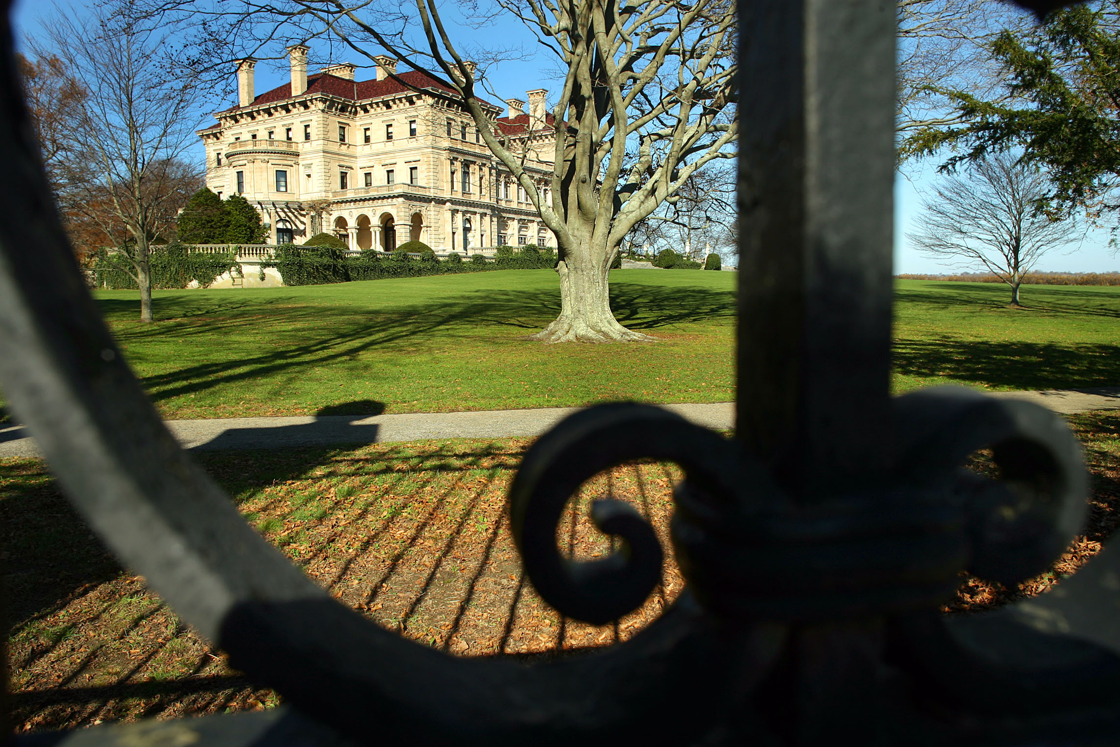 The Breakers mansion, seen through it's ornate wrought iron fence.
