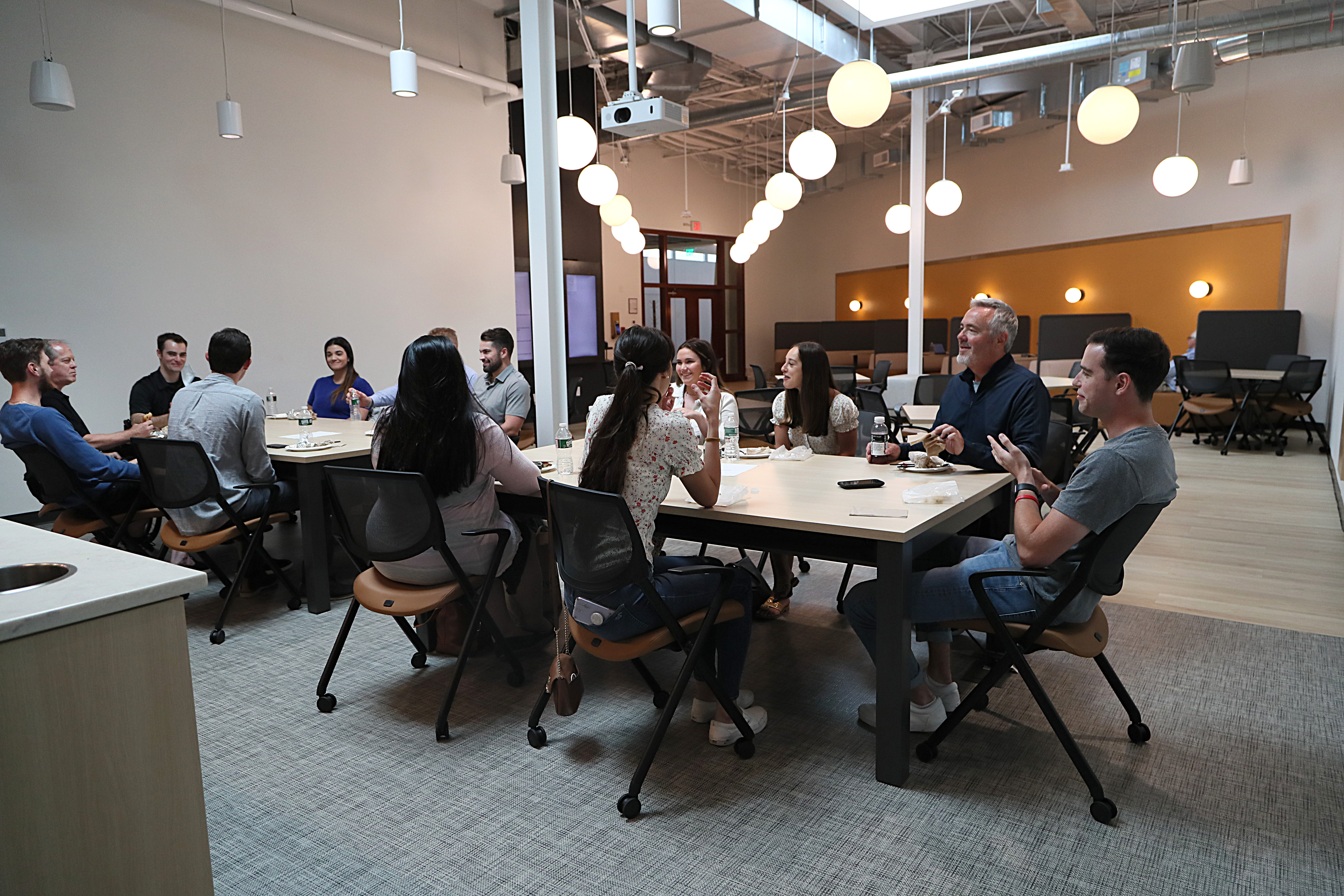 At the WorkBar in Needham, employees of a company meet in the kitchen.