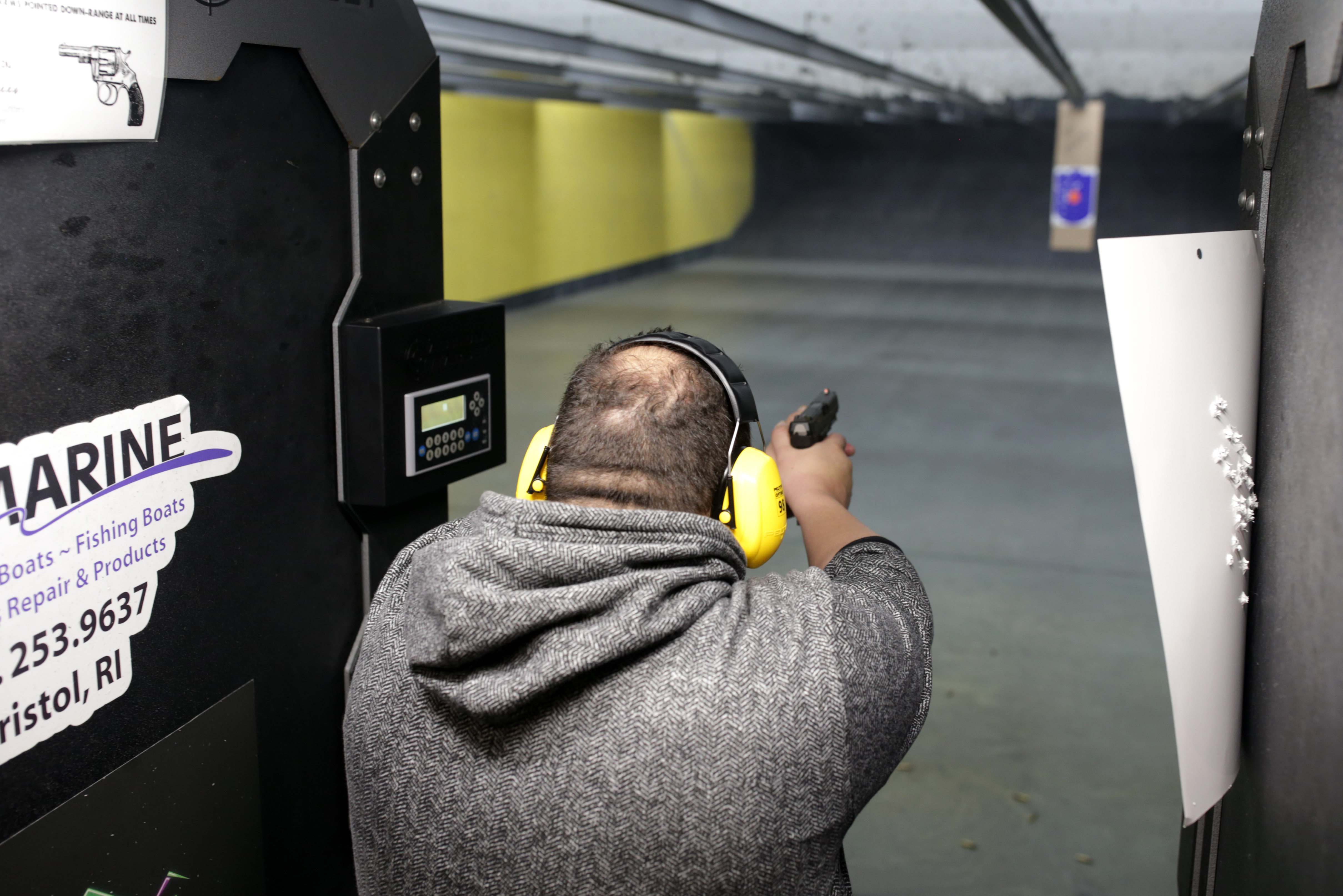A man at the Sakonnet River Outfitters shooting range in Tiverton.