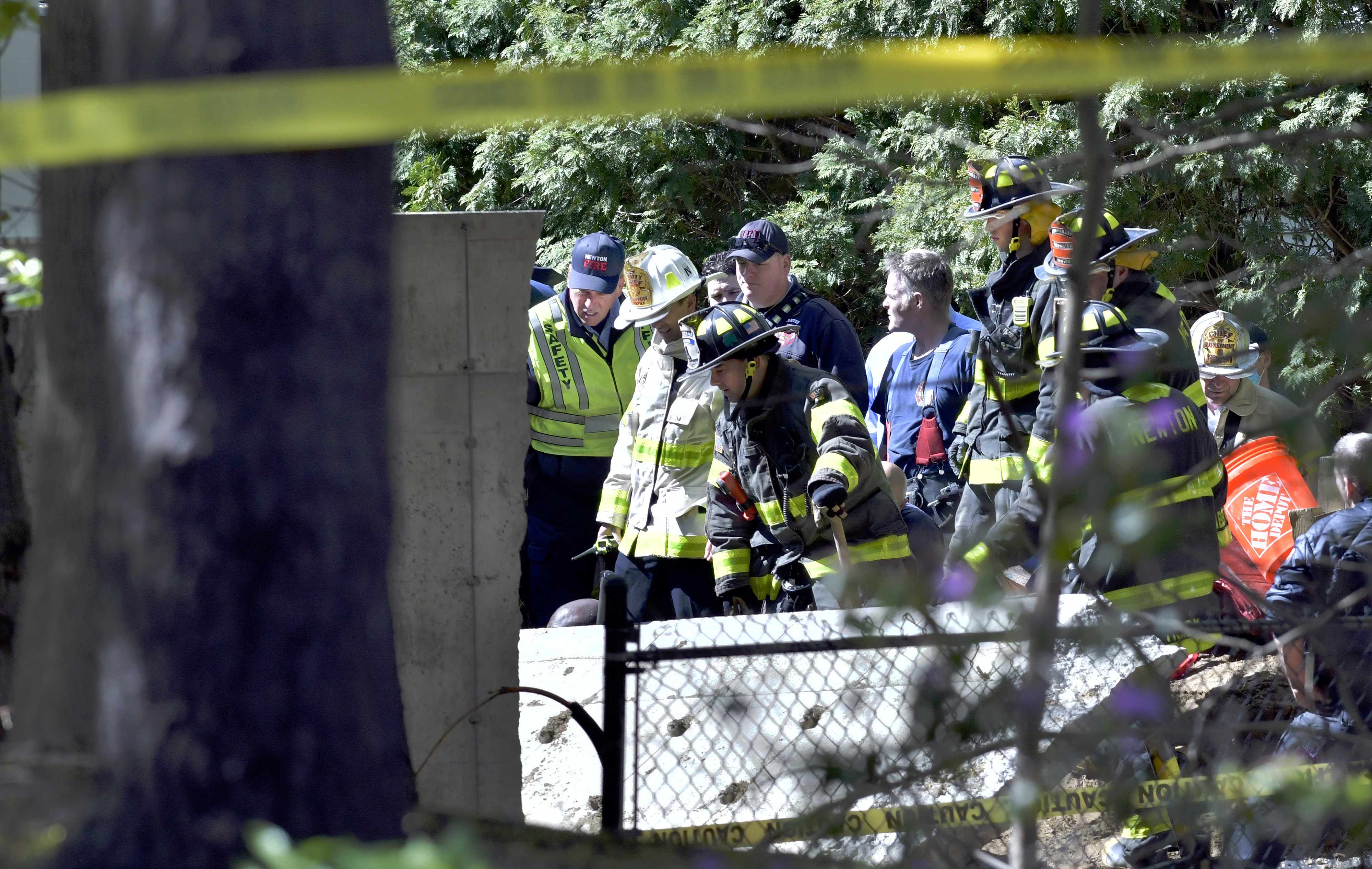 First responders on the scene of a construction site death in Newton, where a concrete wall fell on a worker at the site of a house on Winchester Street.