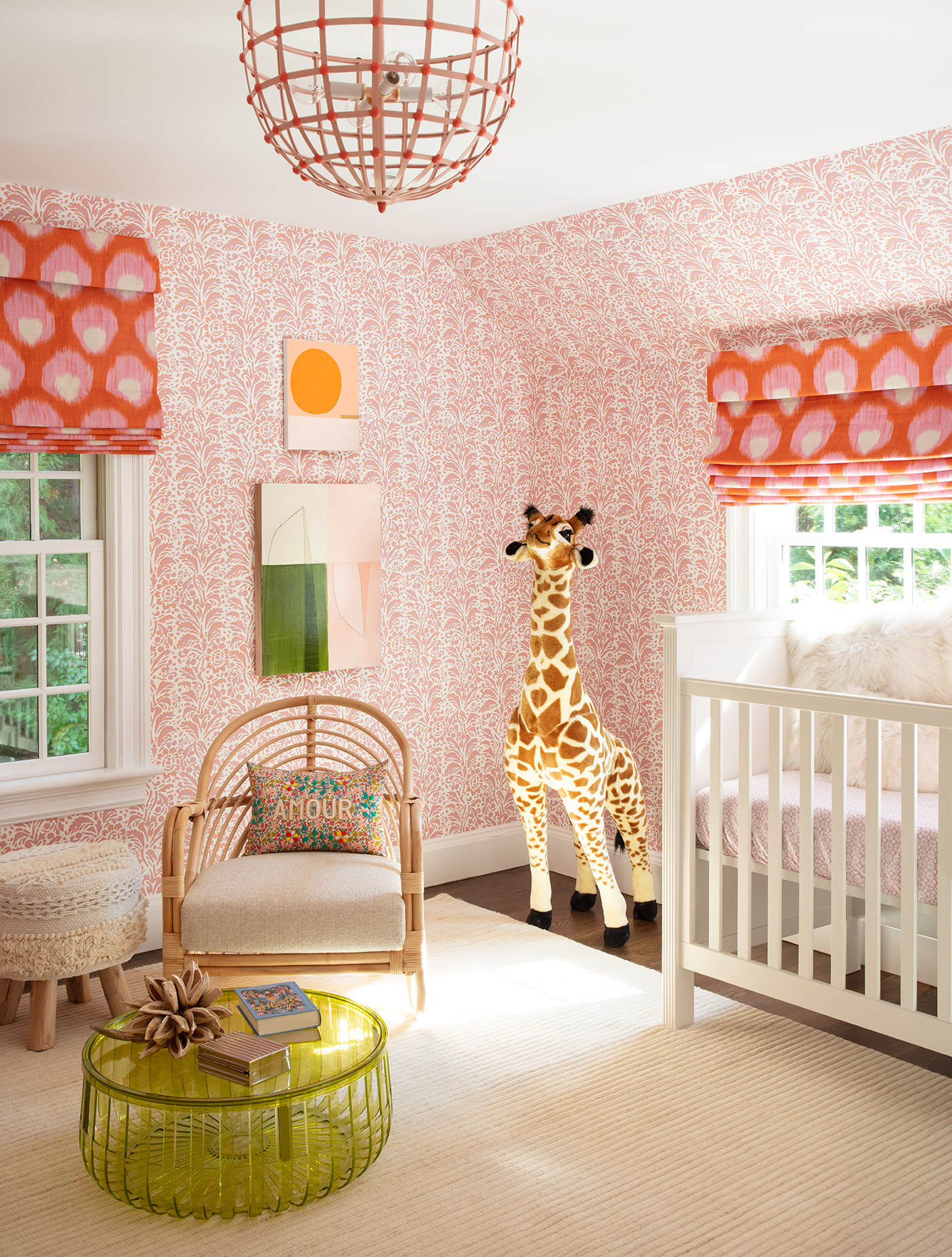 The designer wallpaper seven rooms in this Wellesley house, including this nursery for the clients' second daughter.