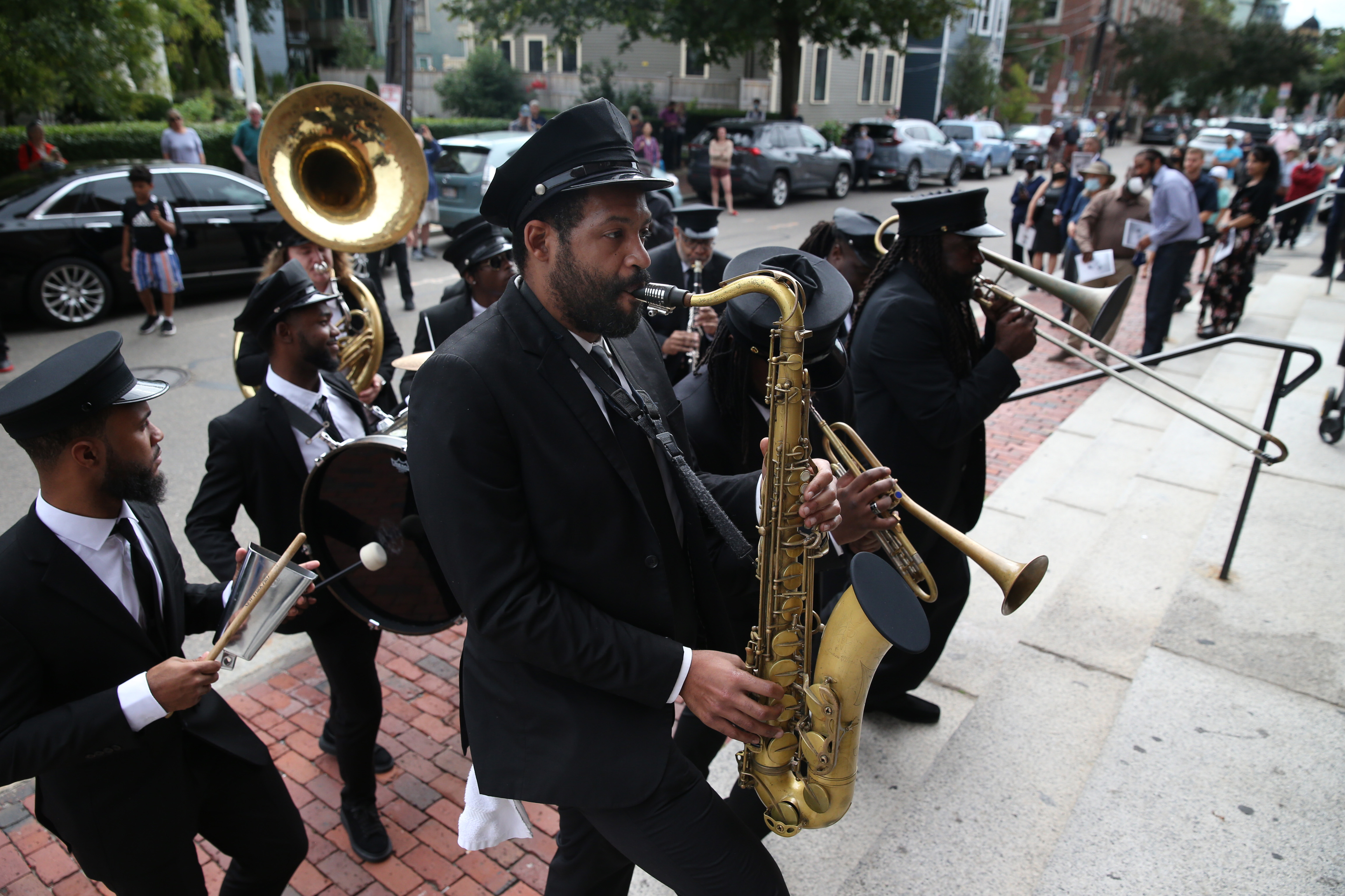 The memorial service was followed by a funeral procession in New Orleans ending in Starlight Square.  At the end of the service, members of the New Orleans Hot Eight Brass Band entered the church.