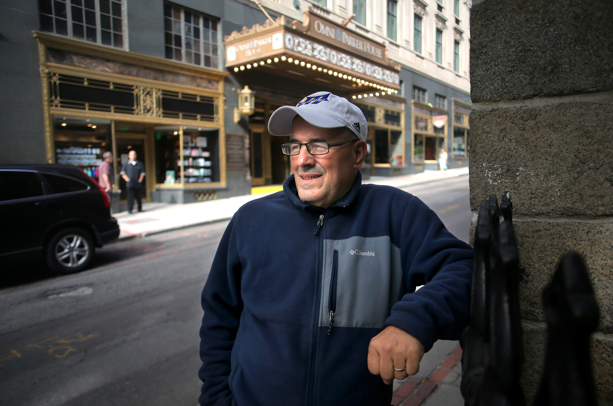 Mehidy Chafa stood outside the Omni Parker House where he works as a banquet server. He was happy to return to work after he was furloughed during the pandemic.