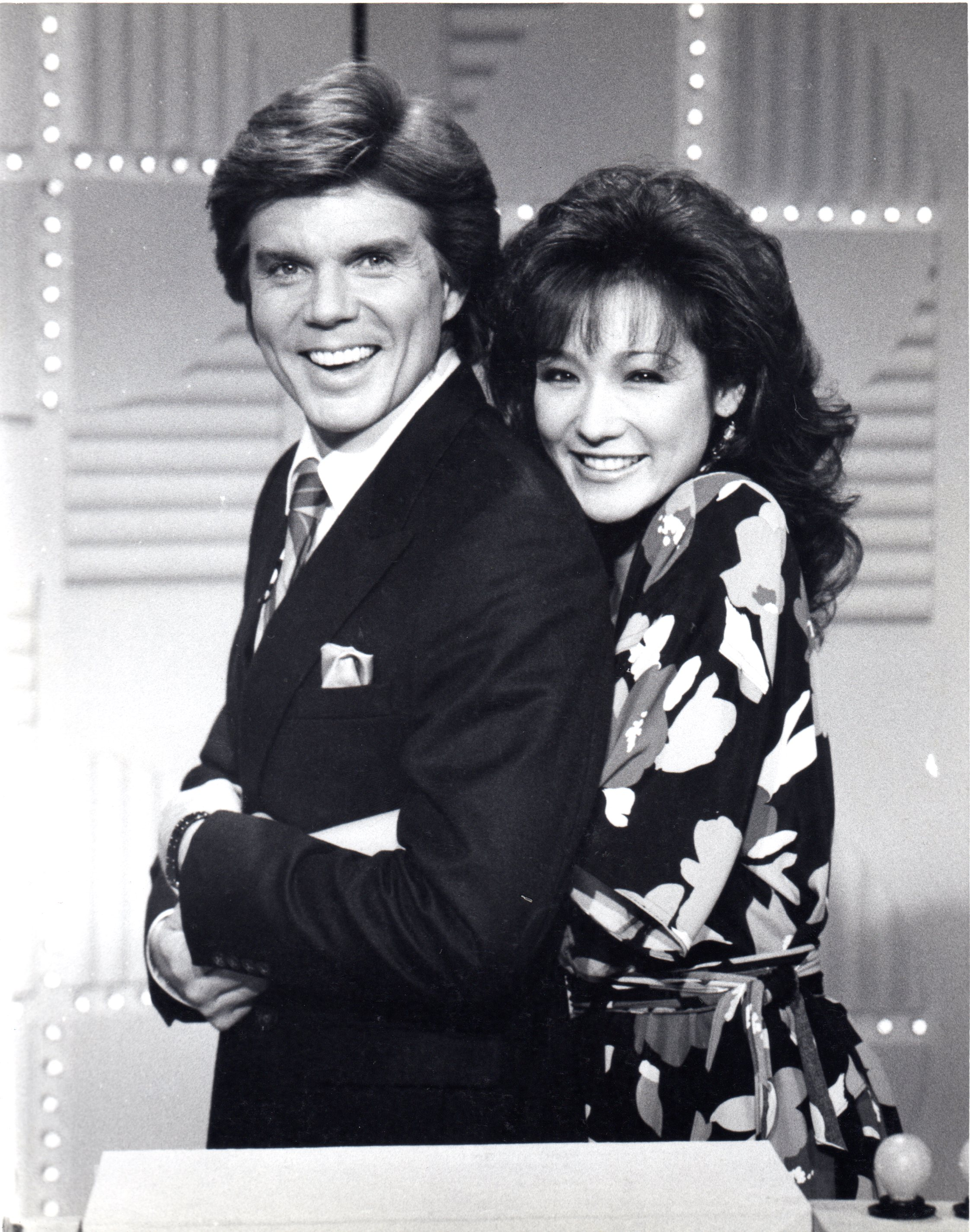 """John Davidson (with Patricia Ayame Thomson) in an advertisement still for the 1985 game show """"Time Machine."""""""