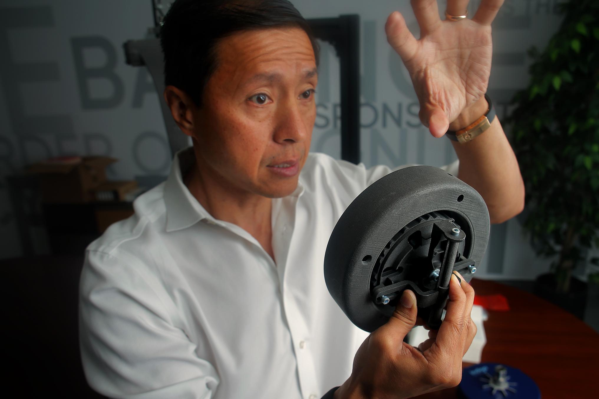 Indigo CEO Will Graylin shows a model of the motorized wheel.