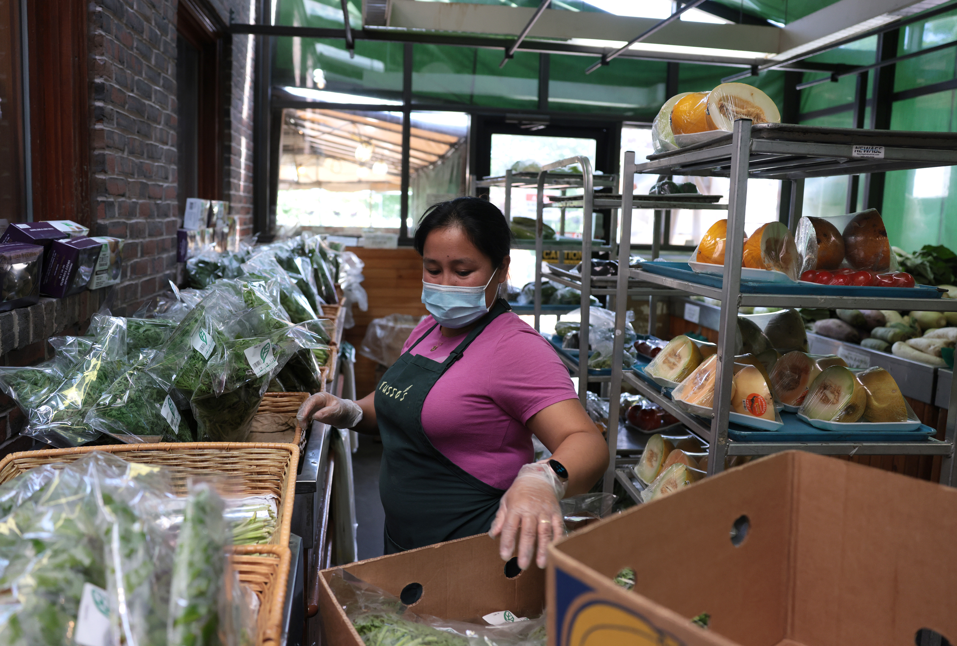Jacquelin Lopez stocked the shelves with fresh herbs at Russo's.