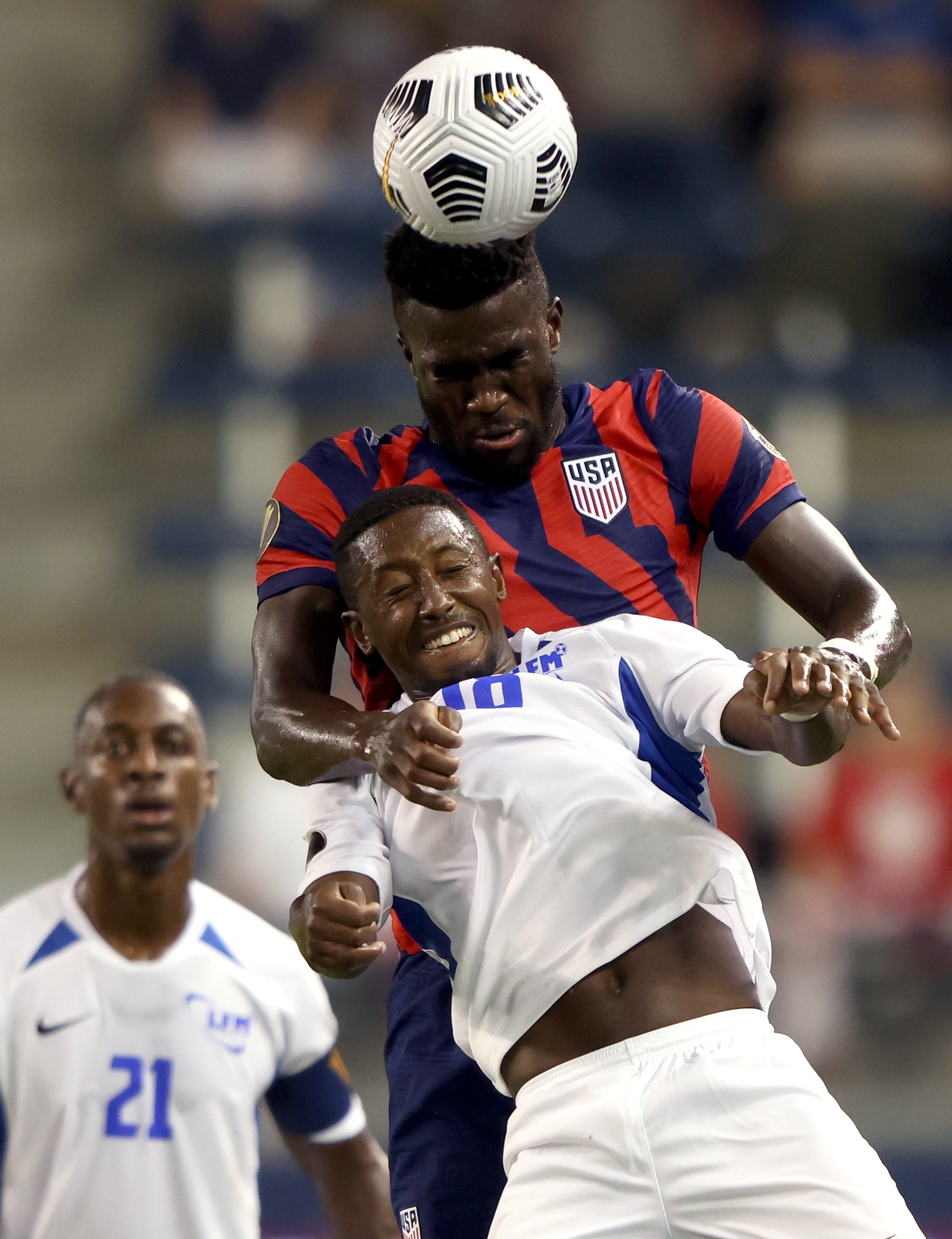Daryl Dike of the United States beats Samuel Camille of Martinique for a head ball during Thursday night's 2021 CONCACAF Gold Cup match at Children's Mercy Park in Kansas City, Kansas.