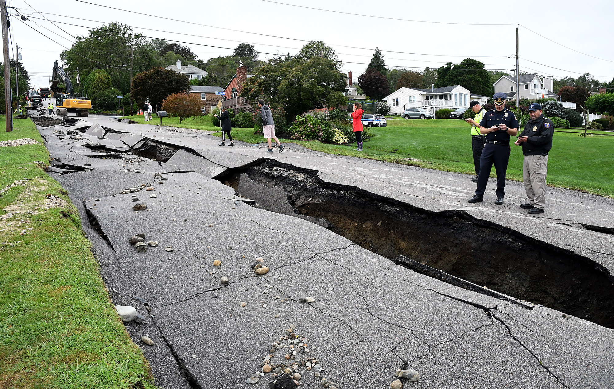 Fairview Lane in Portsmouth, RI lays crumbled Thursday after the remnants of Hurricane Ida passed over the area Wednesday night and early Thursday morning dumping several inches of rain.