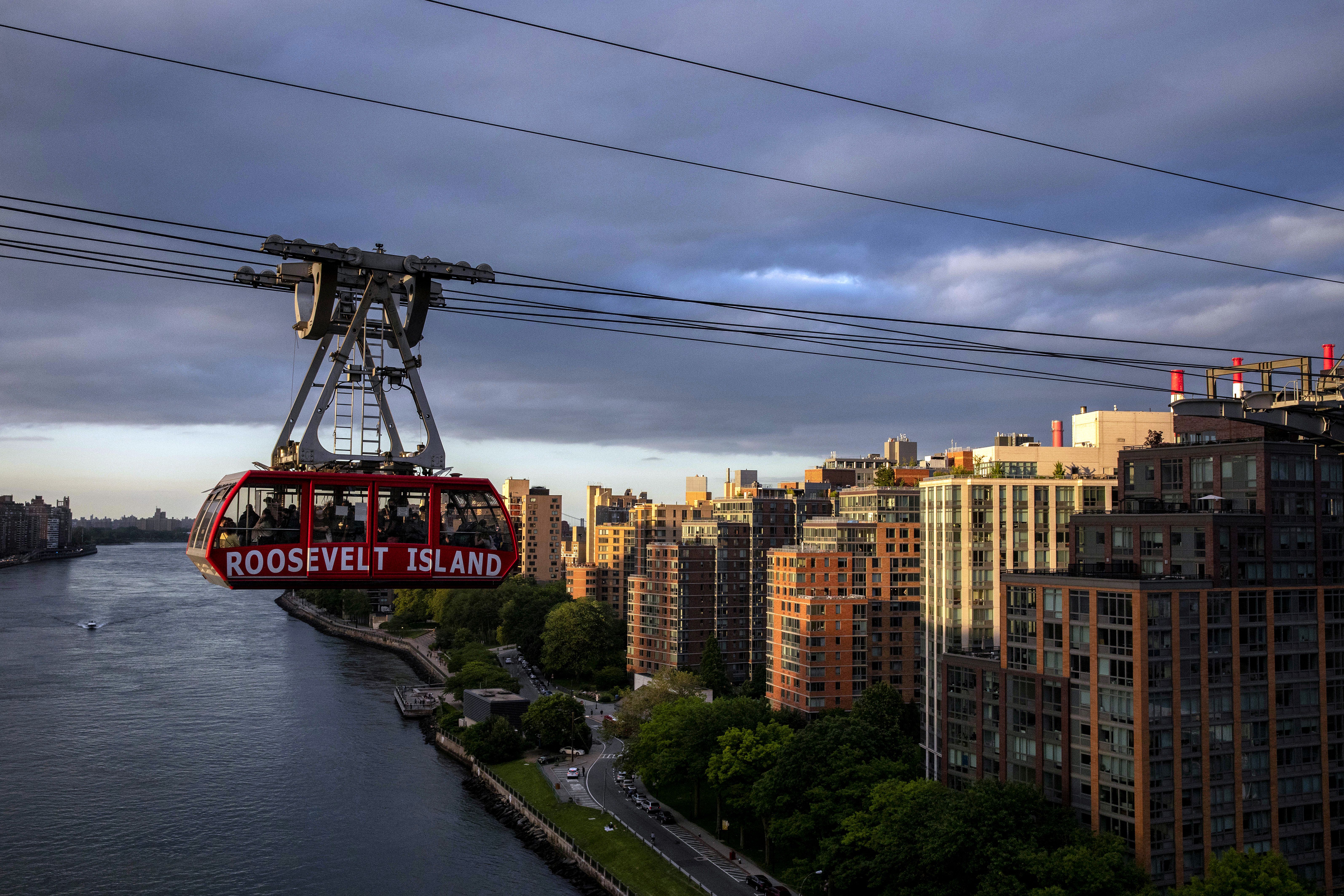 The tram to Roosevelt Island crosses the East River from Manhattan on Monday, June 12, 2021.