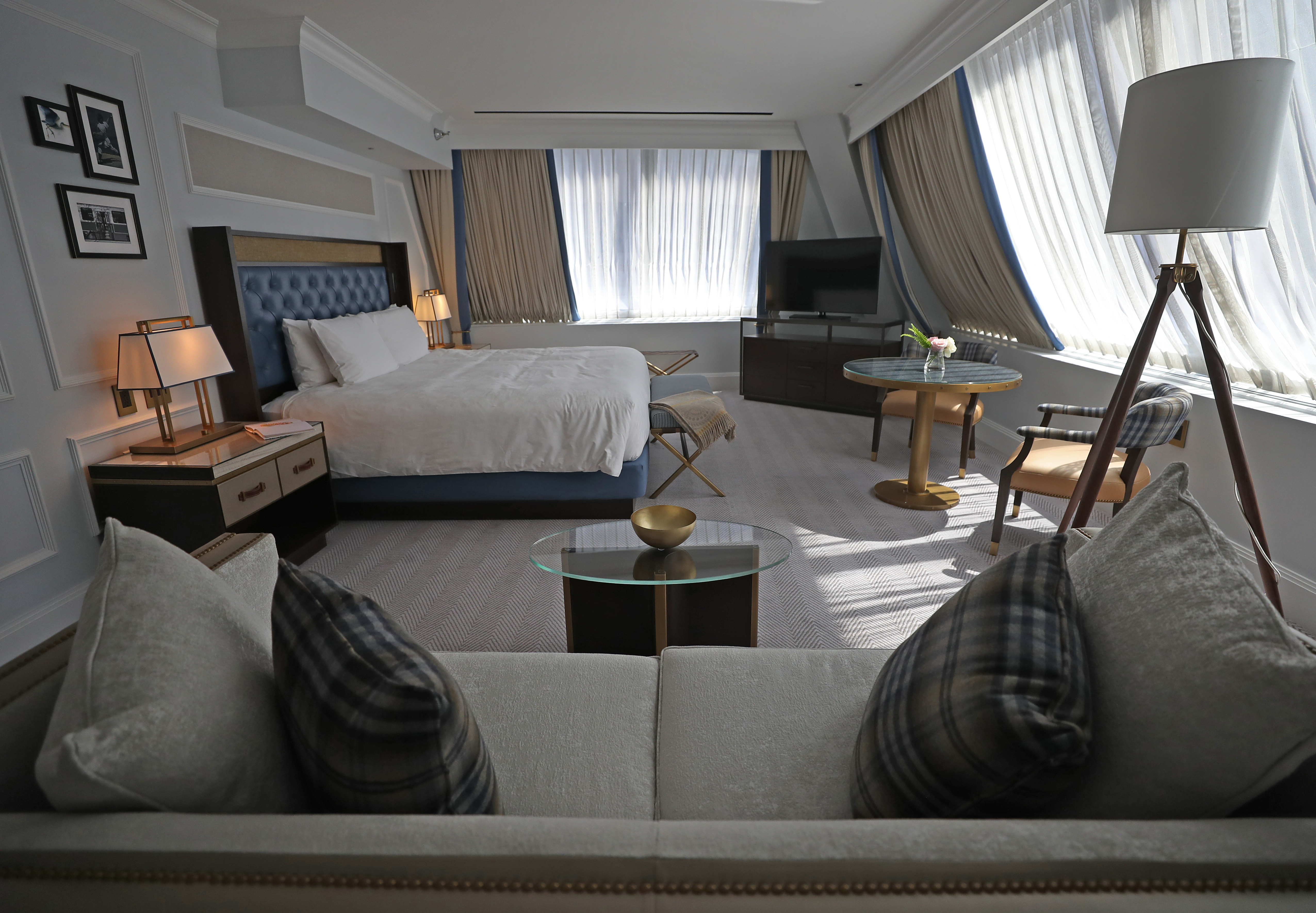 An executive guest room at the Langham Boston.