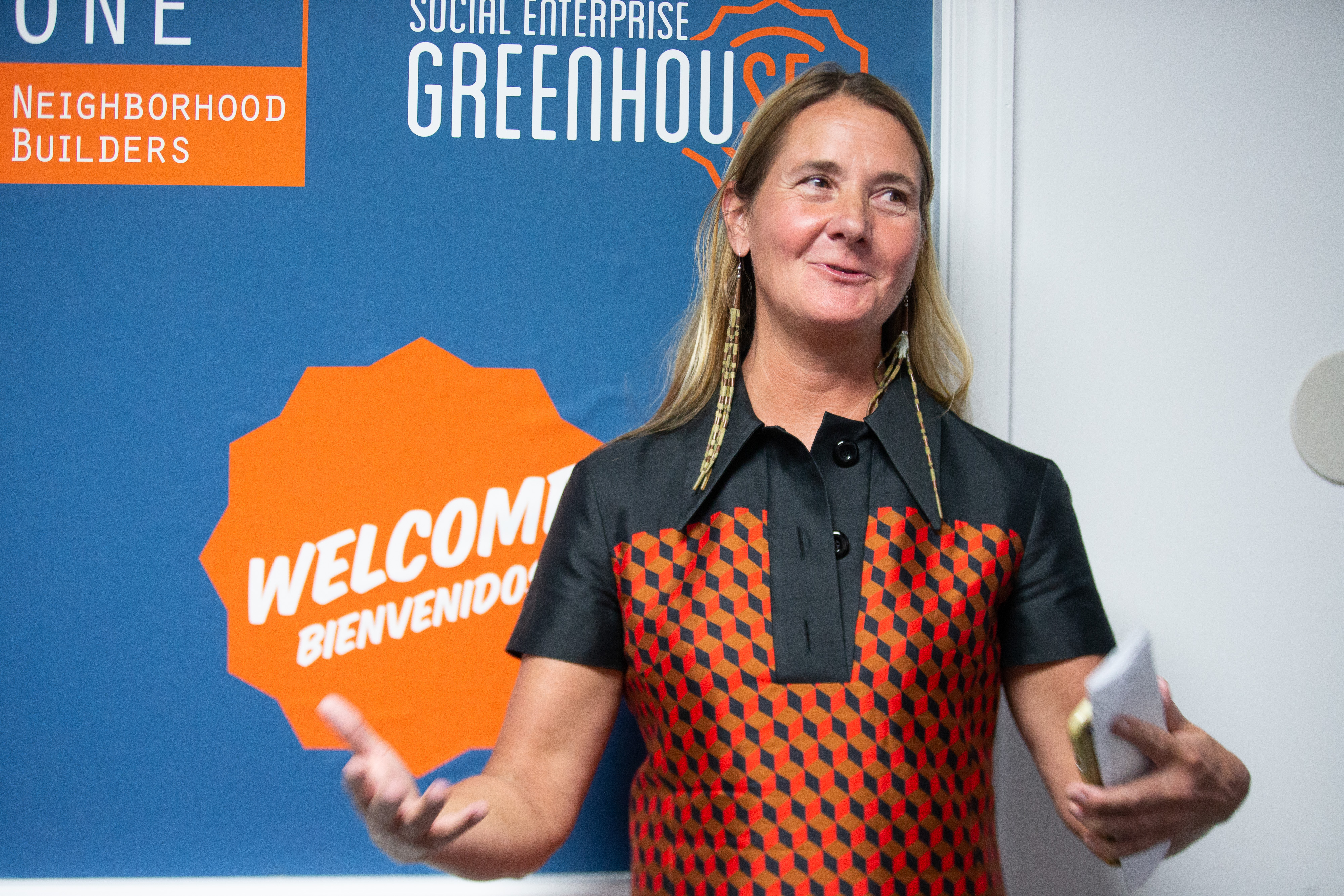Kelly Ramirez, co-founder and CEO of Social Enterprise Greenhouse, welcomes guests to the new business support center developed by Social Enterprise Greenhouse and ONE Neighborhood Builders in Providence, Rhode Island.