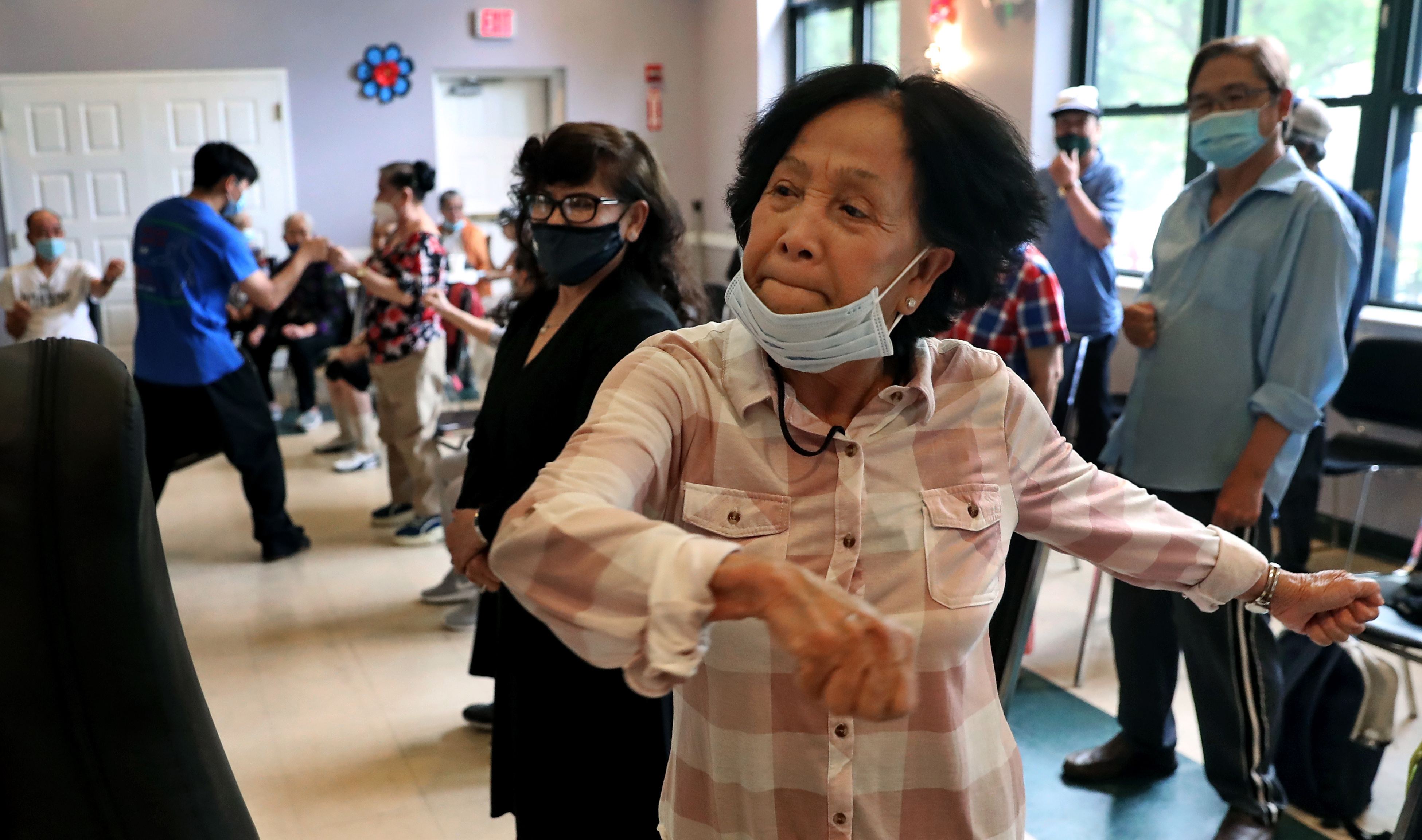 Ton Do, 75, practiced throwing a punch during a class in self-defense at VietAID's community center in Fields Corner.