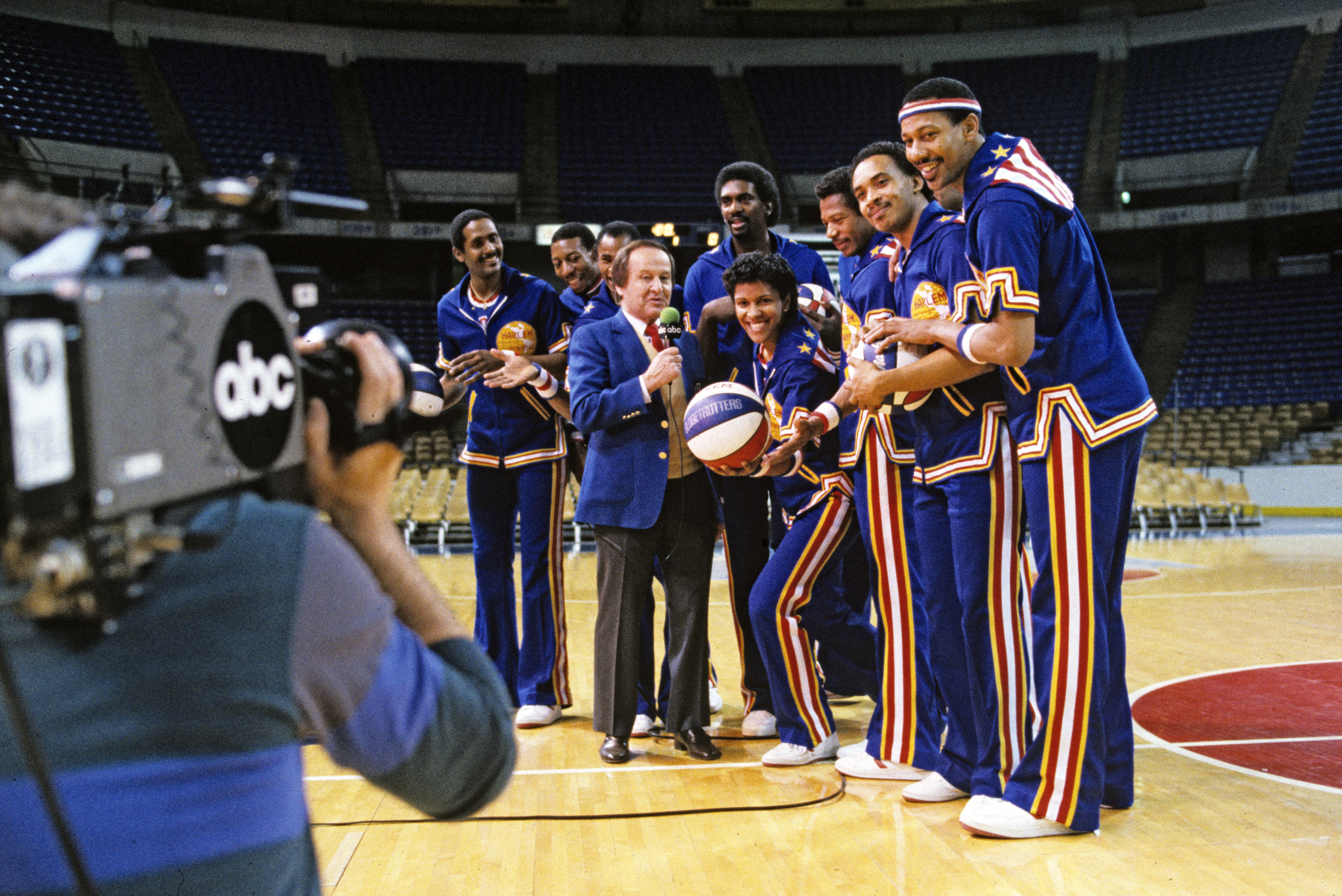 "The Harlem Globetrotters crowded Jim McKay courtside during a February 1986 episode of ""Wide World of Sports."" Interviewing athletes mid-game is common now, but it was unseen before the program."