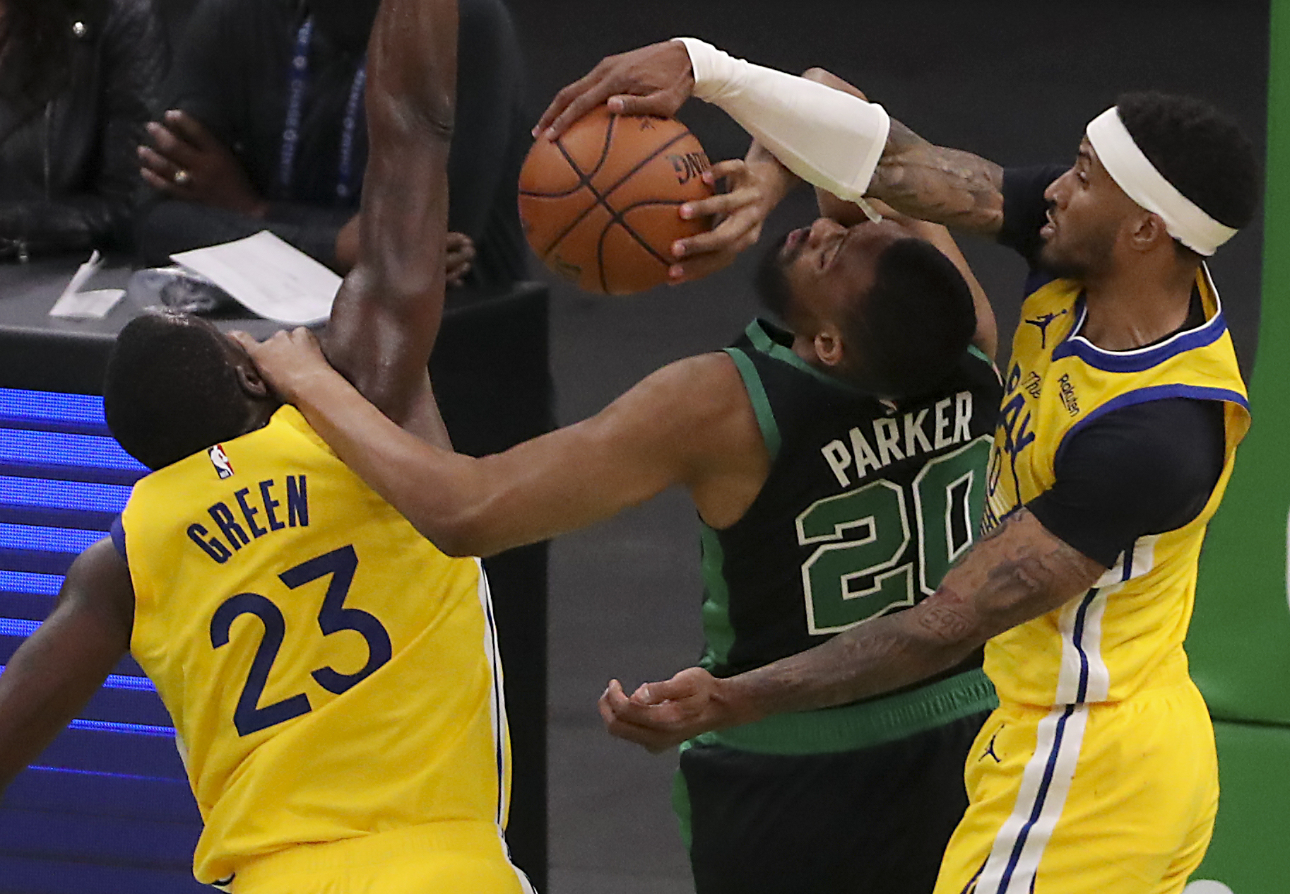 The newest Celtic Jabari Parker (20) made a shot blocked by Gary Peyton II from Golden State in the third quarter.  But Parker still made a few timely shots in his debut with the team.