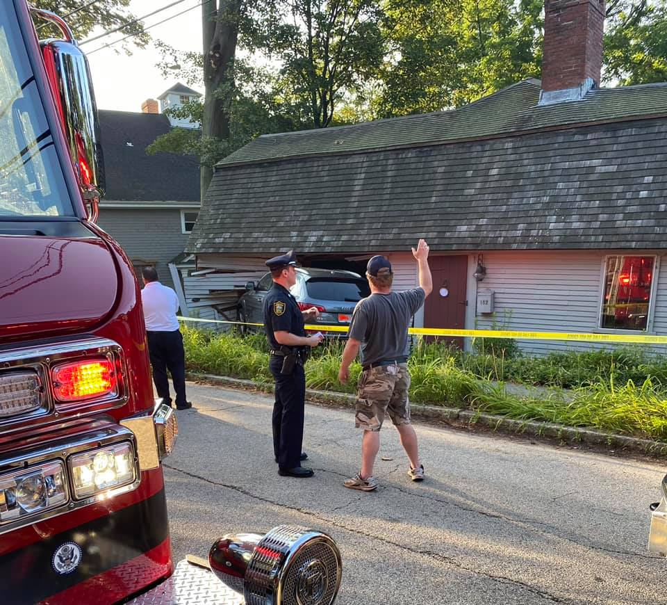 An SUV appeared to have crashed into the side of a historical home on North Street in Hingham.
