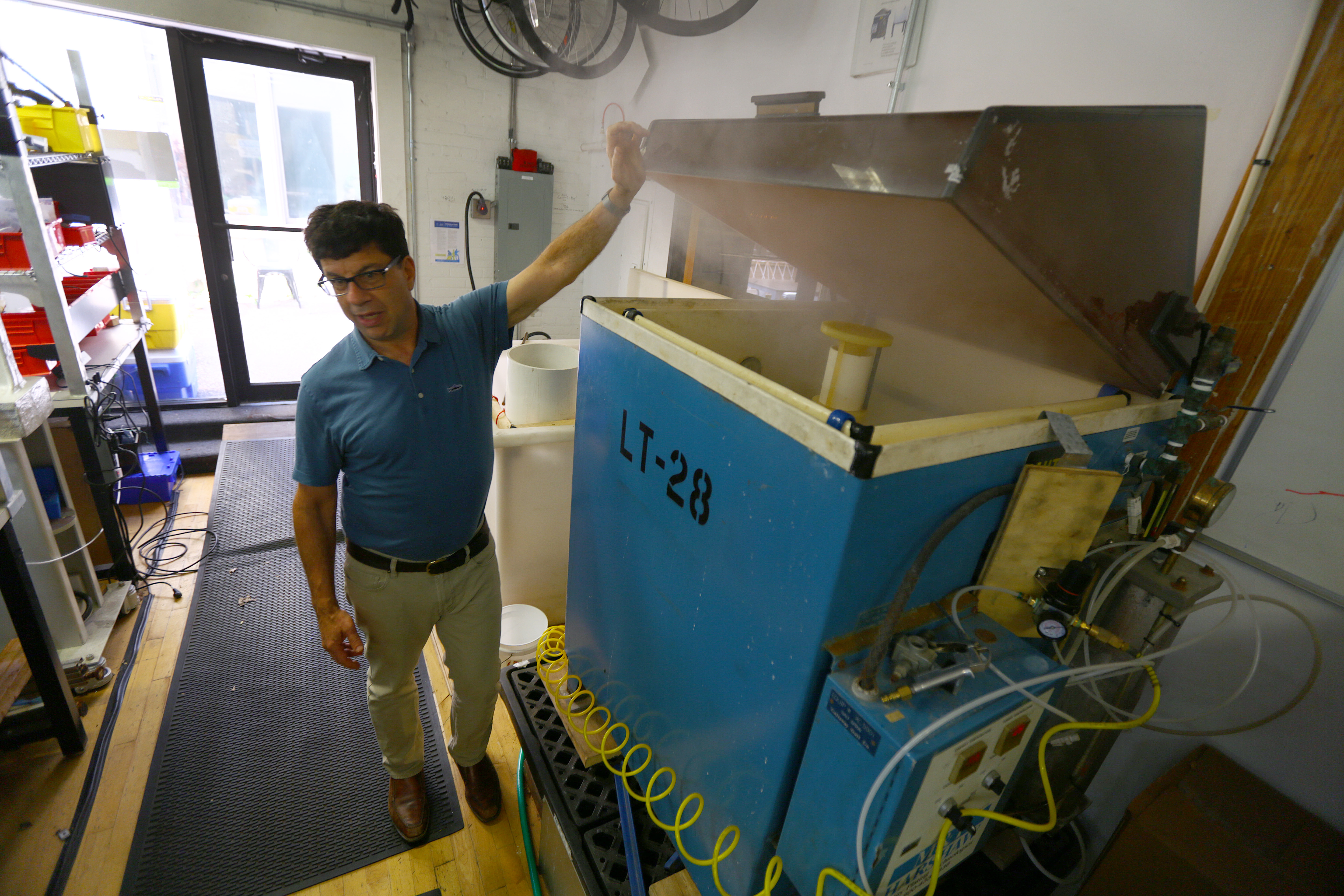 David Michael, director of mechanical engineering at Superpedestrian, stood next to a salt fog machine, which conducts accelerated salt corrosion tests.
