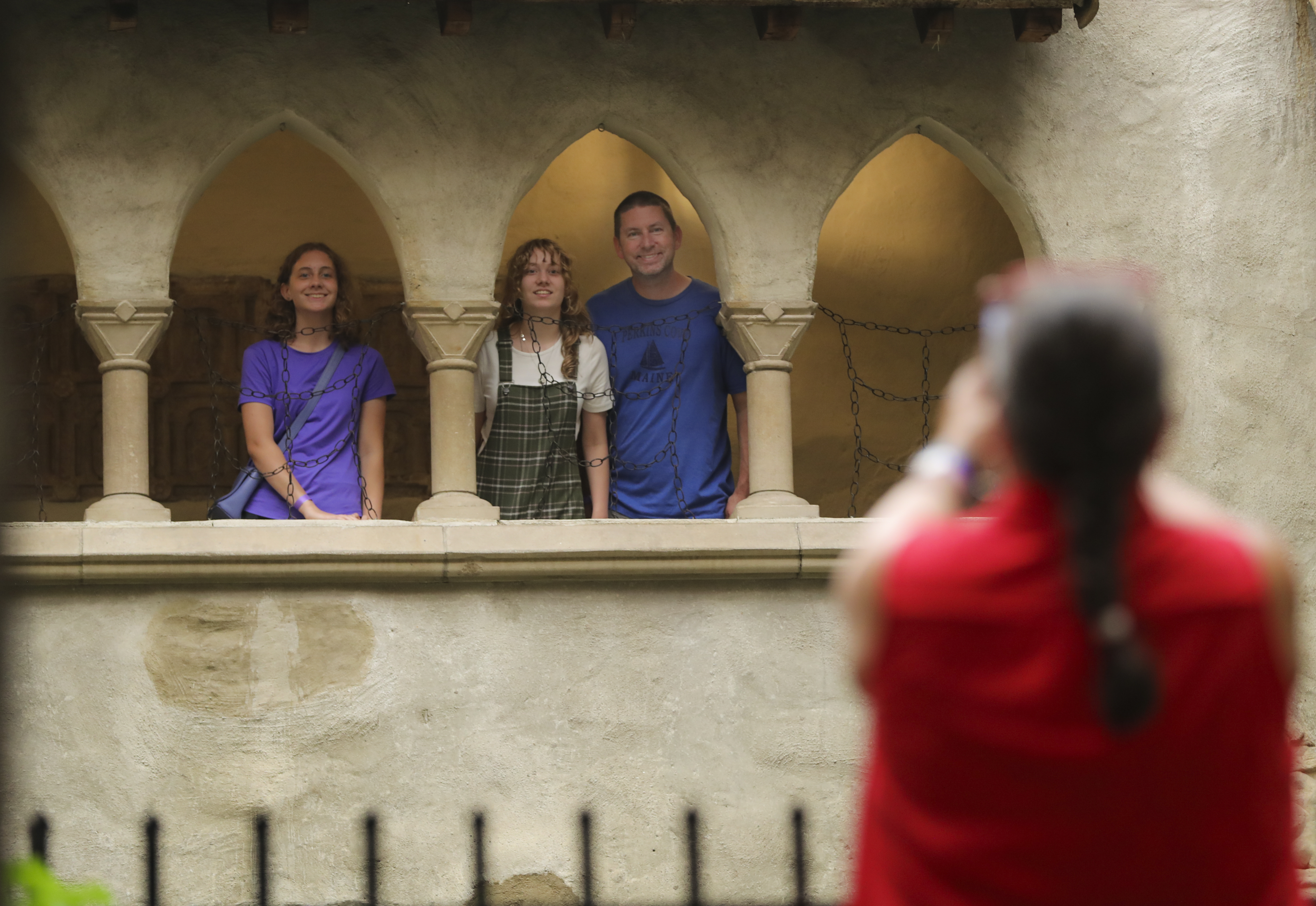 Lisa Ehleringer takes a photo of her daughters (left to right), Vivi, 17, Lizzy, 13, and Lisa's husband, Jeff Ehleringer, in the inner courtyard of the Hammond Castle Museum.