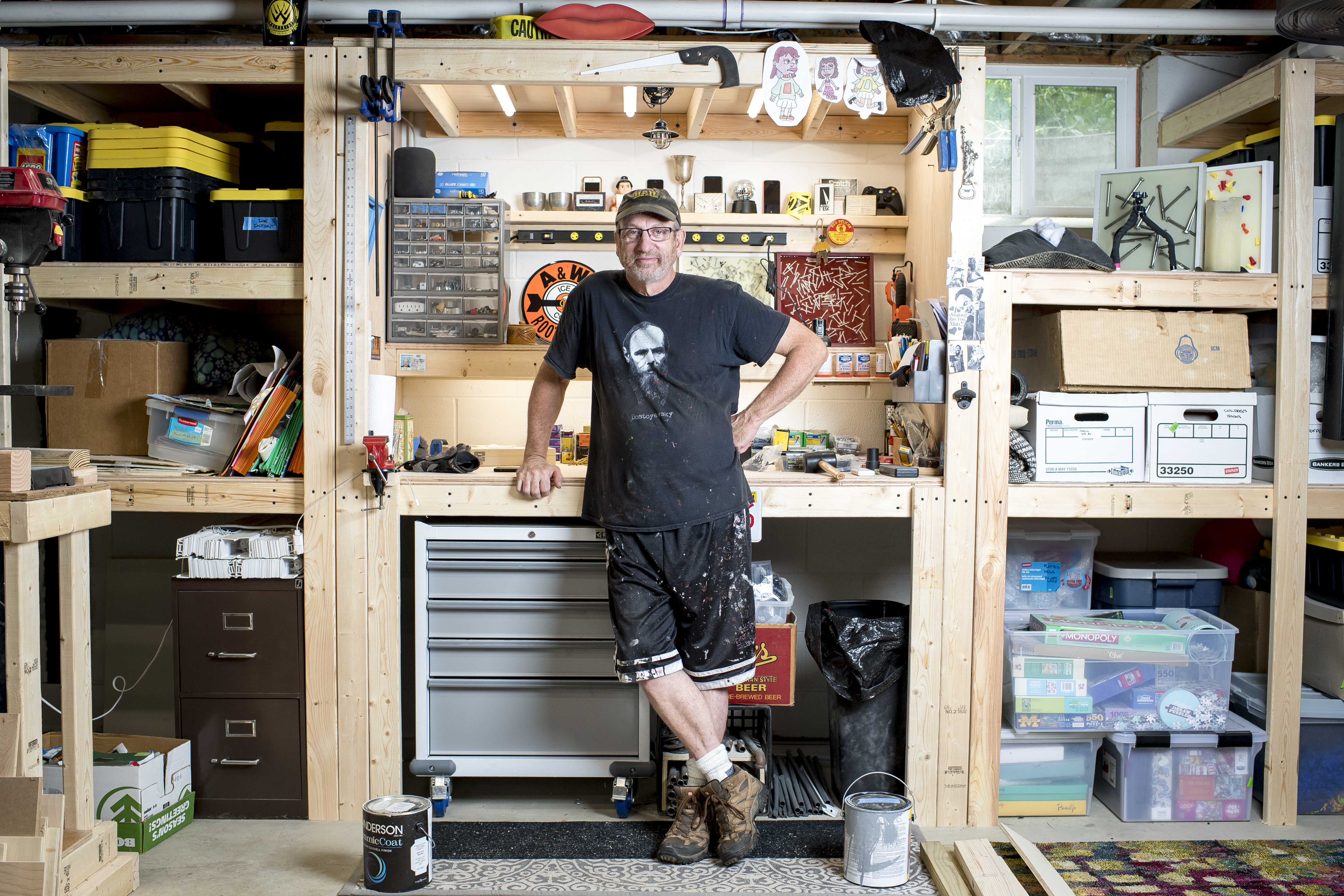 John Schumacher stood in his basement workshop at his home in Ann Arbor, Mich. Schumacher spent his career working as a middle school teacher in Hanover, Mass., until he retired early to move back to his home state of Michigan in December 2020.