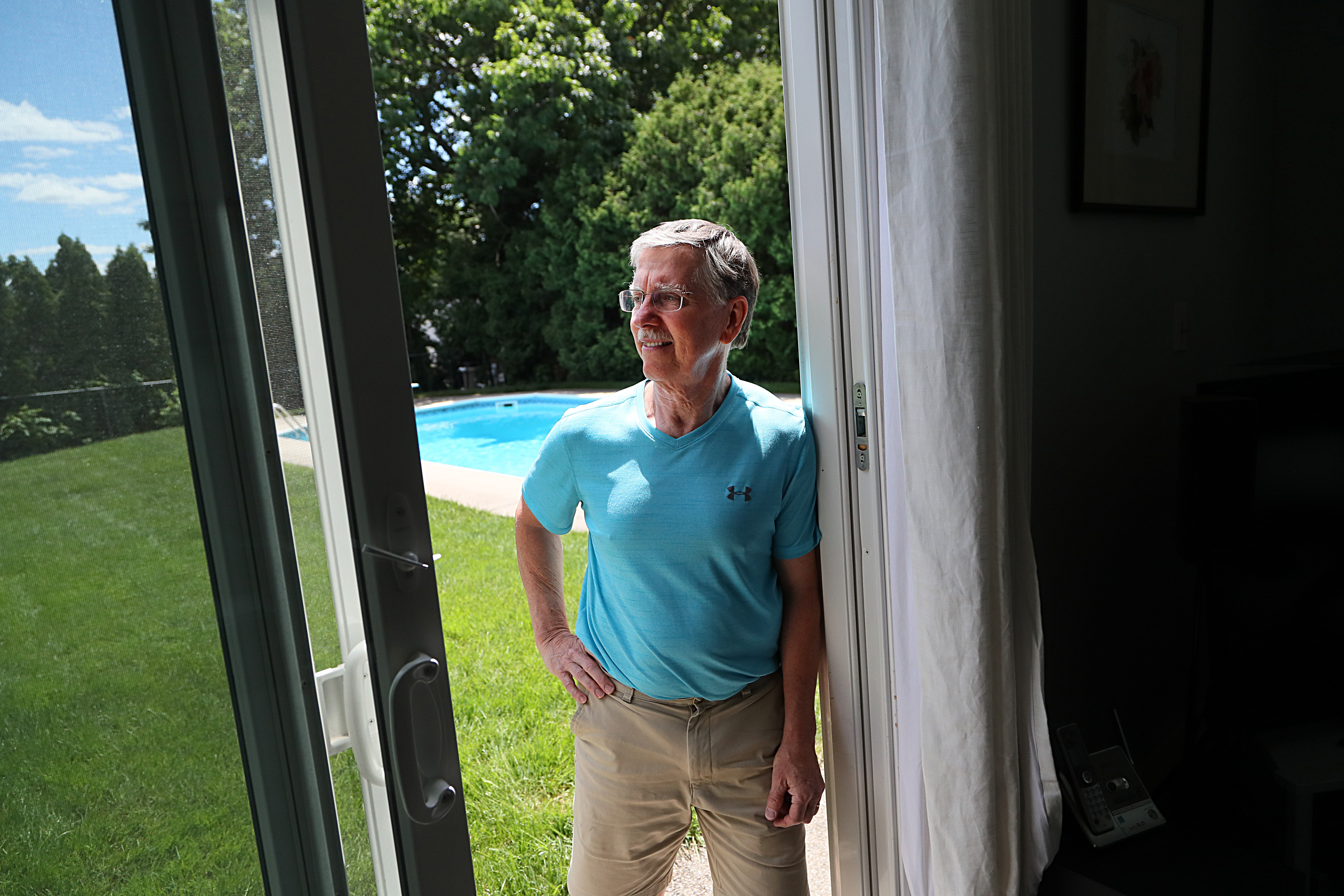 John Hine, a senior business analyst for Bay State Health, took advantage of technology to postpone his retirement and work part time from his home office, which looks out at his backyard pool.