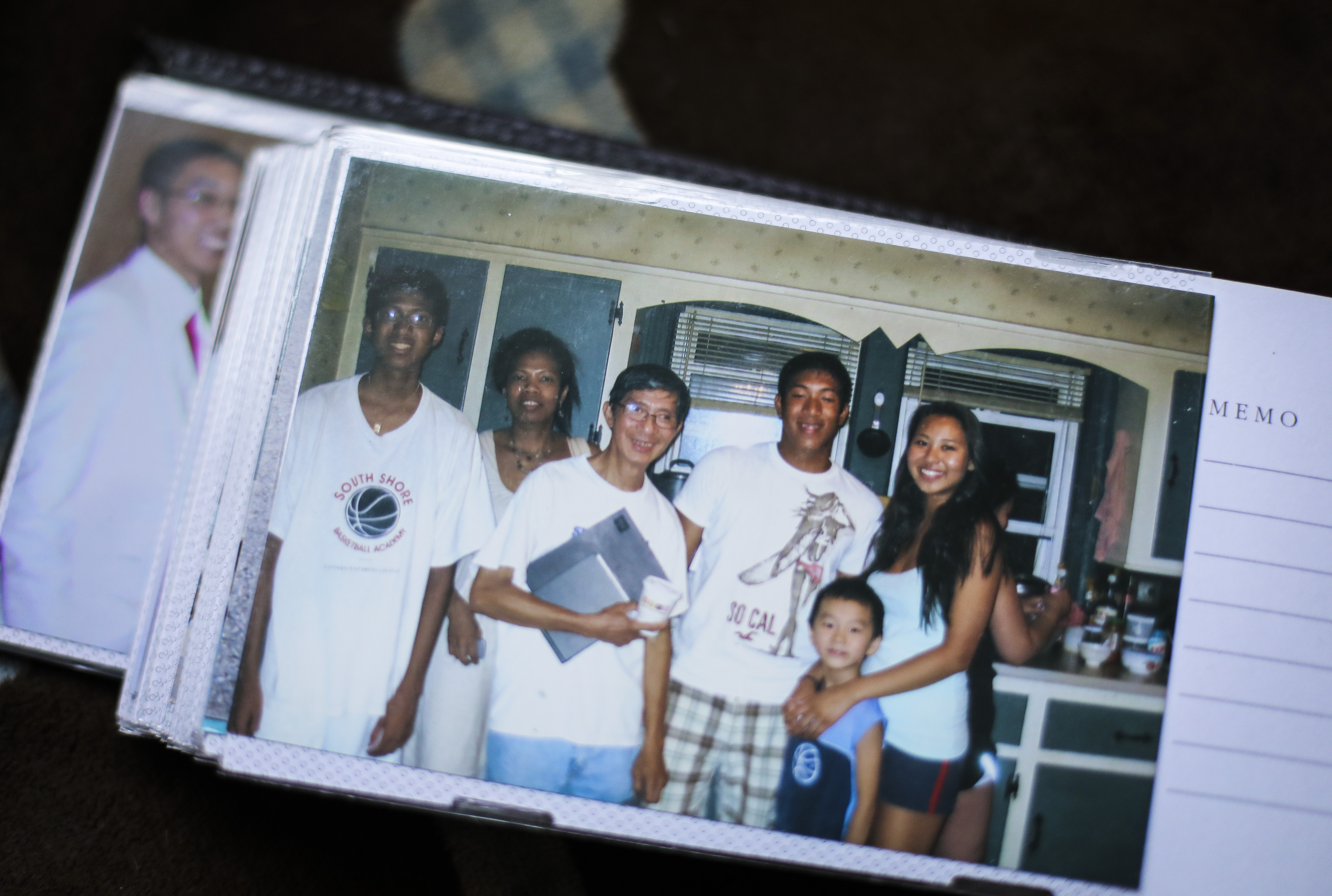 A photo of Liem Tran (third from left) from around five years ago sat in an album of family photos.
