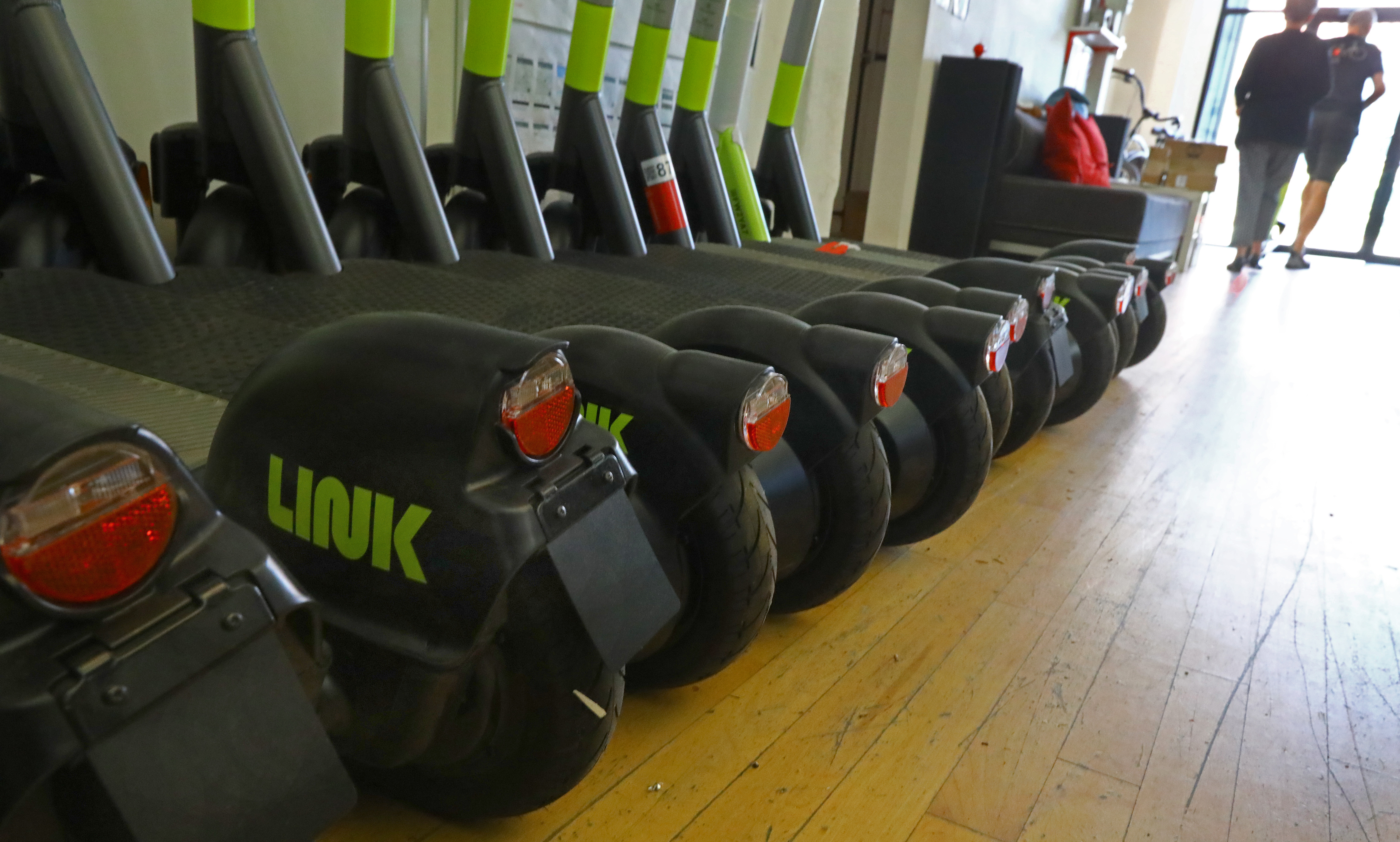 LINK scooters parked in the company's multiple-use space.
