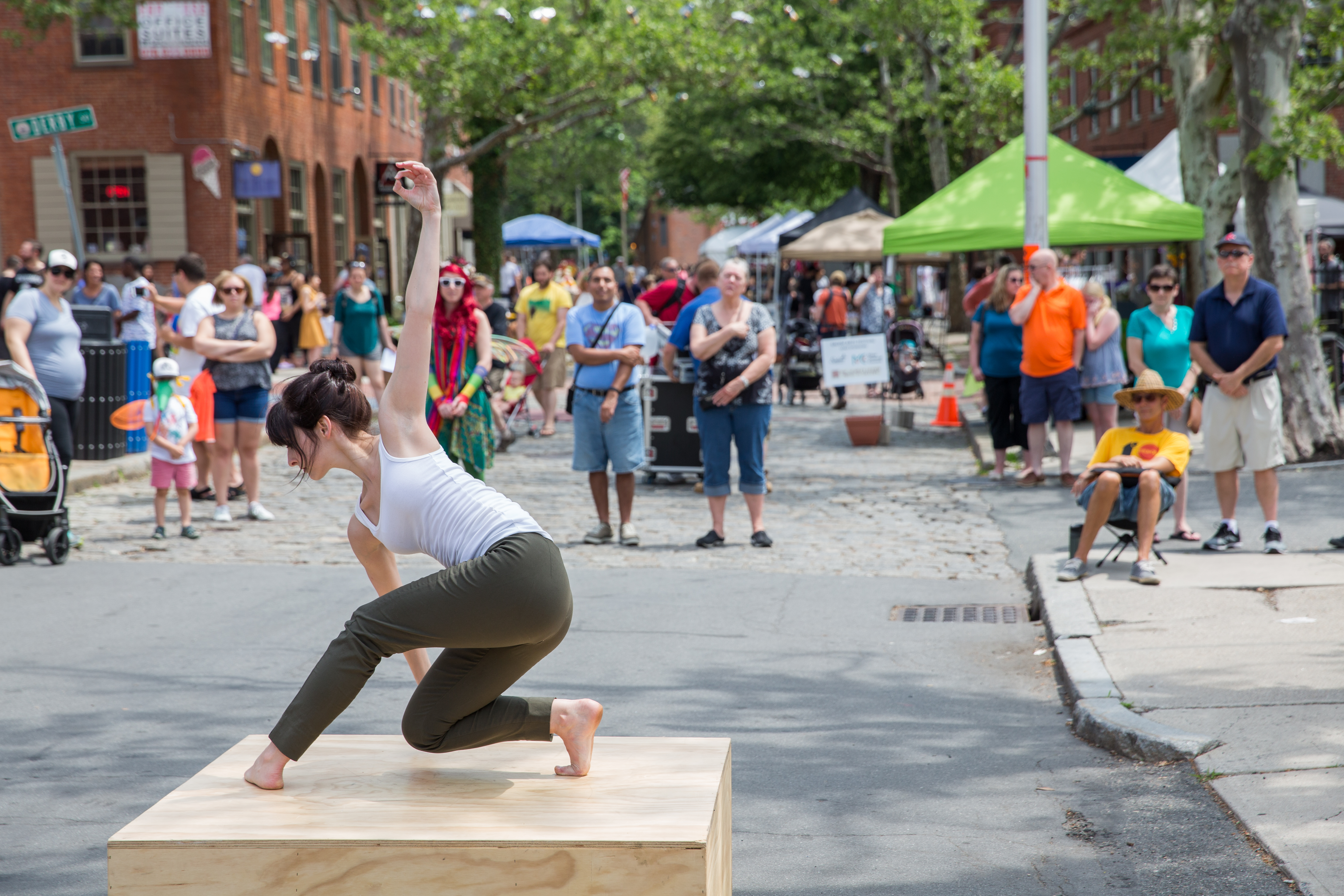 Dancers can be seen performing on the tiny four-by-four stages of the Salem Arts Festival.