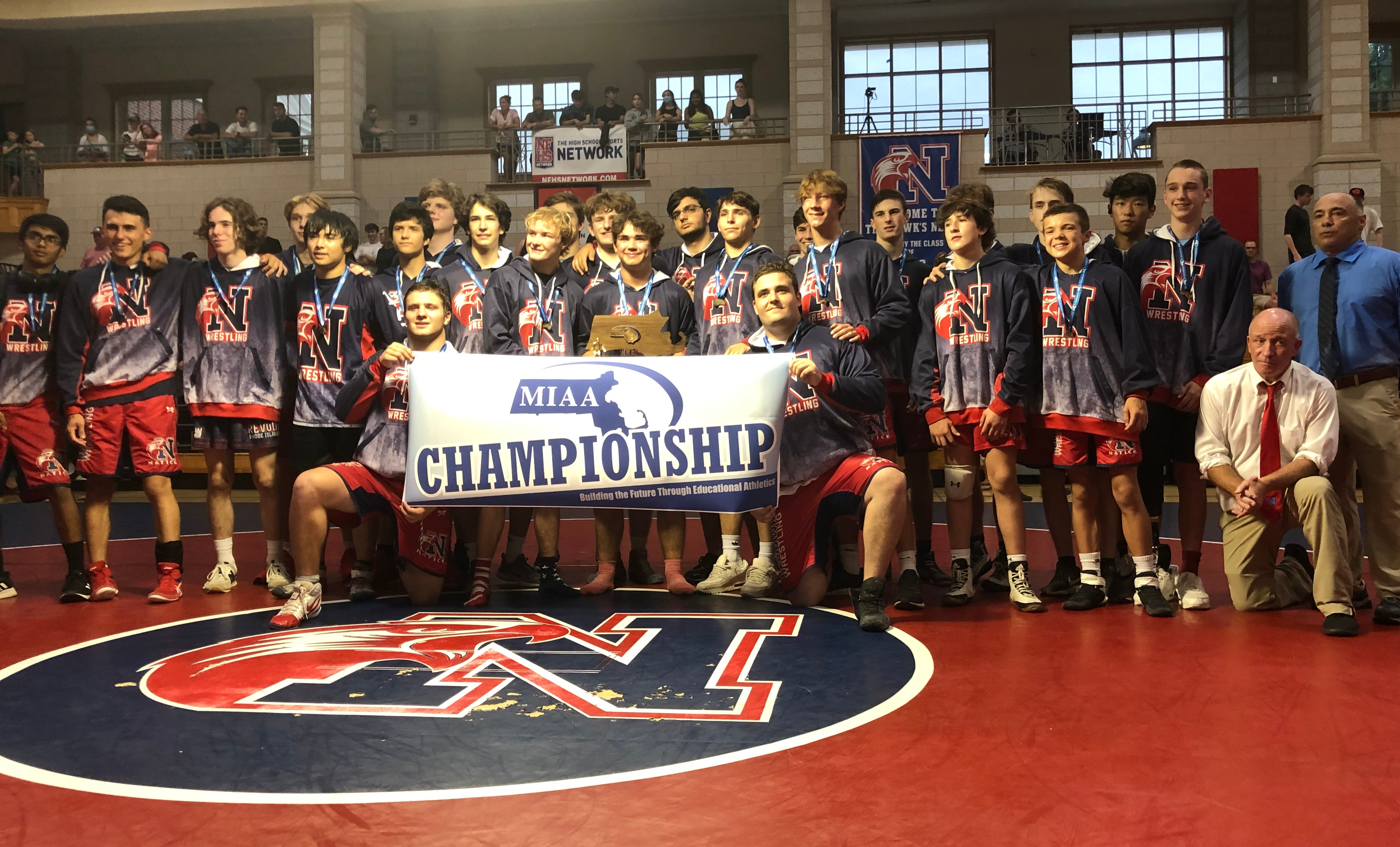 Natick's wrestling team concluded a 14-0 season with the MIAA Division 2 double-meet championship.