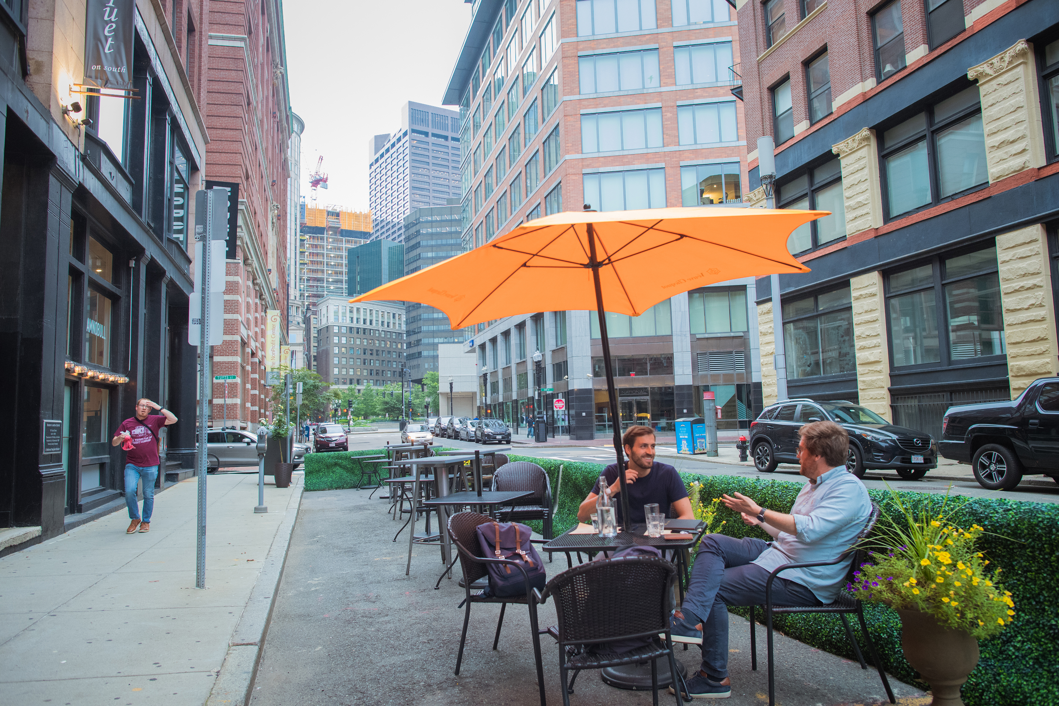 Augustin Jalenques (left) and Antoine Robiliard sat outside at Troquet on South restaurant in Boston on Aug. 4.