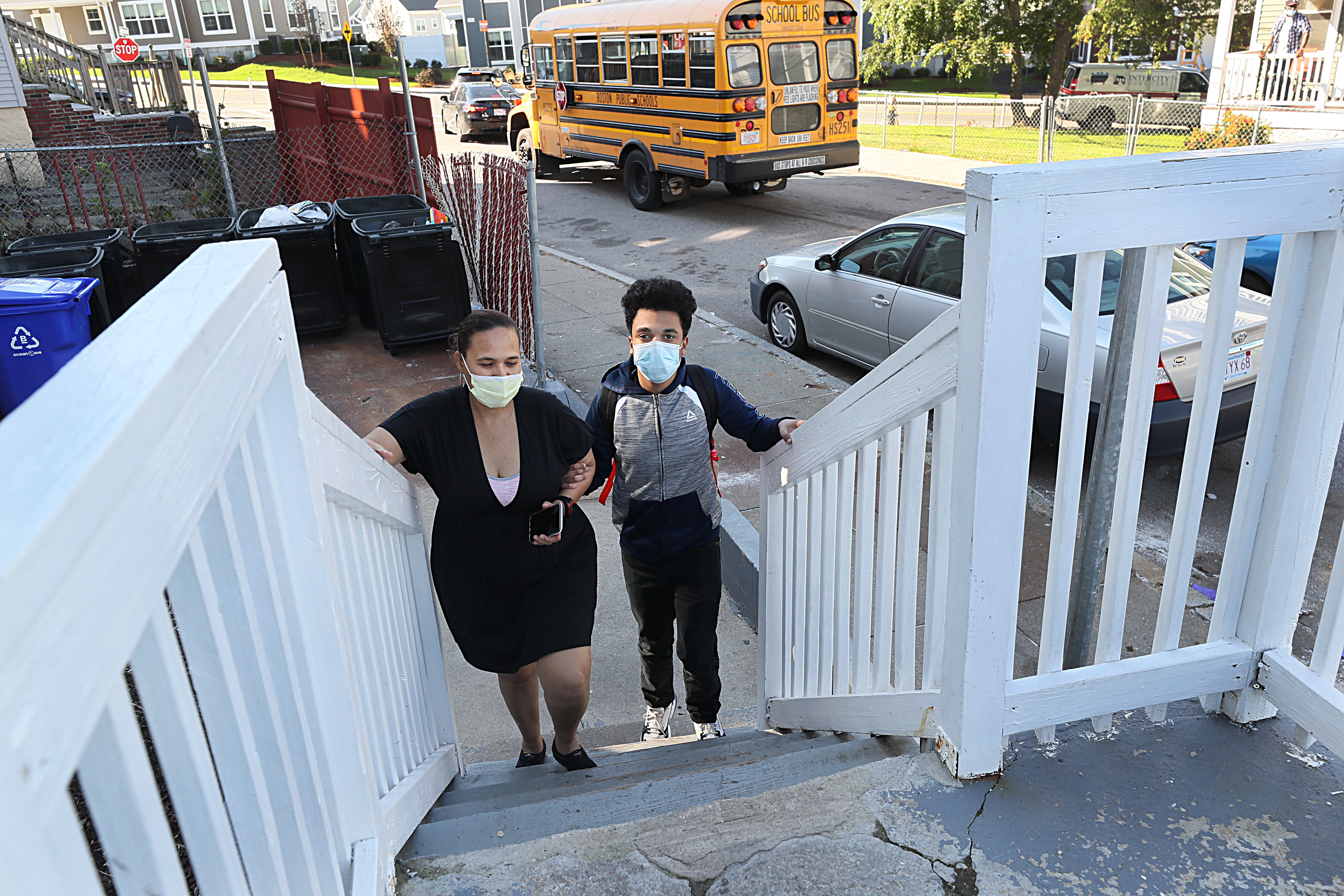 Axel Baez Ramon, with his mother, Zoraida, returned to his home in Mattapan from school Friday.