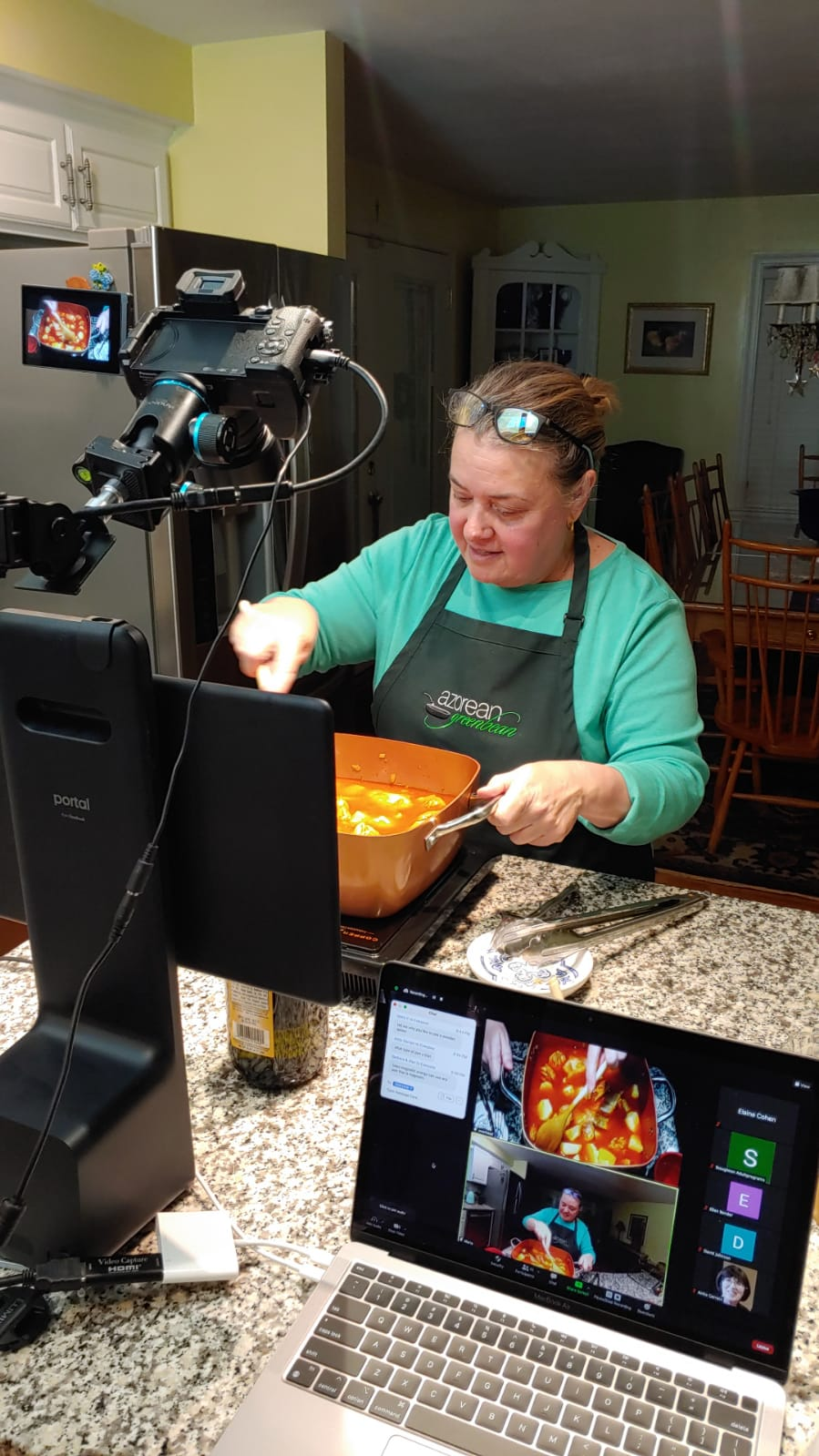 New Bedford resident Maria Lawton, a.k.a. the Azorean Green Bean, teaches a virtual class for the Stoughton Public Library, making stewed chicken and potatoes. Lawton is cooking inside her home because the library is closed for cooking demonstrations.