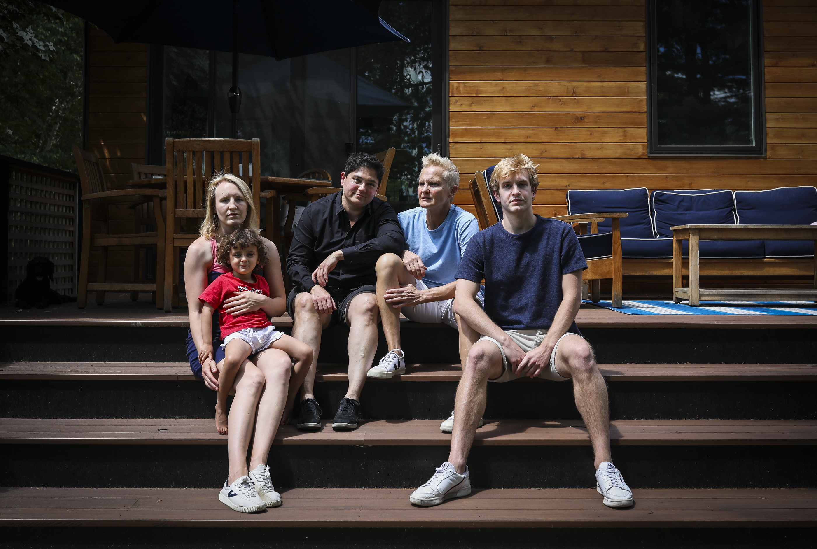 Estey Ticknor had two children with her first husband before before coming out as gay and marrying her partner, Dr. Tara Lagu. Her children – daughters Persis Ticknor-Swanson and three-year-old Freddie Ticknor-Lagu, and son Calvin Ticknor-Swanson, sit at the Ticknor-Lagu home in Easthampton.