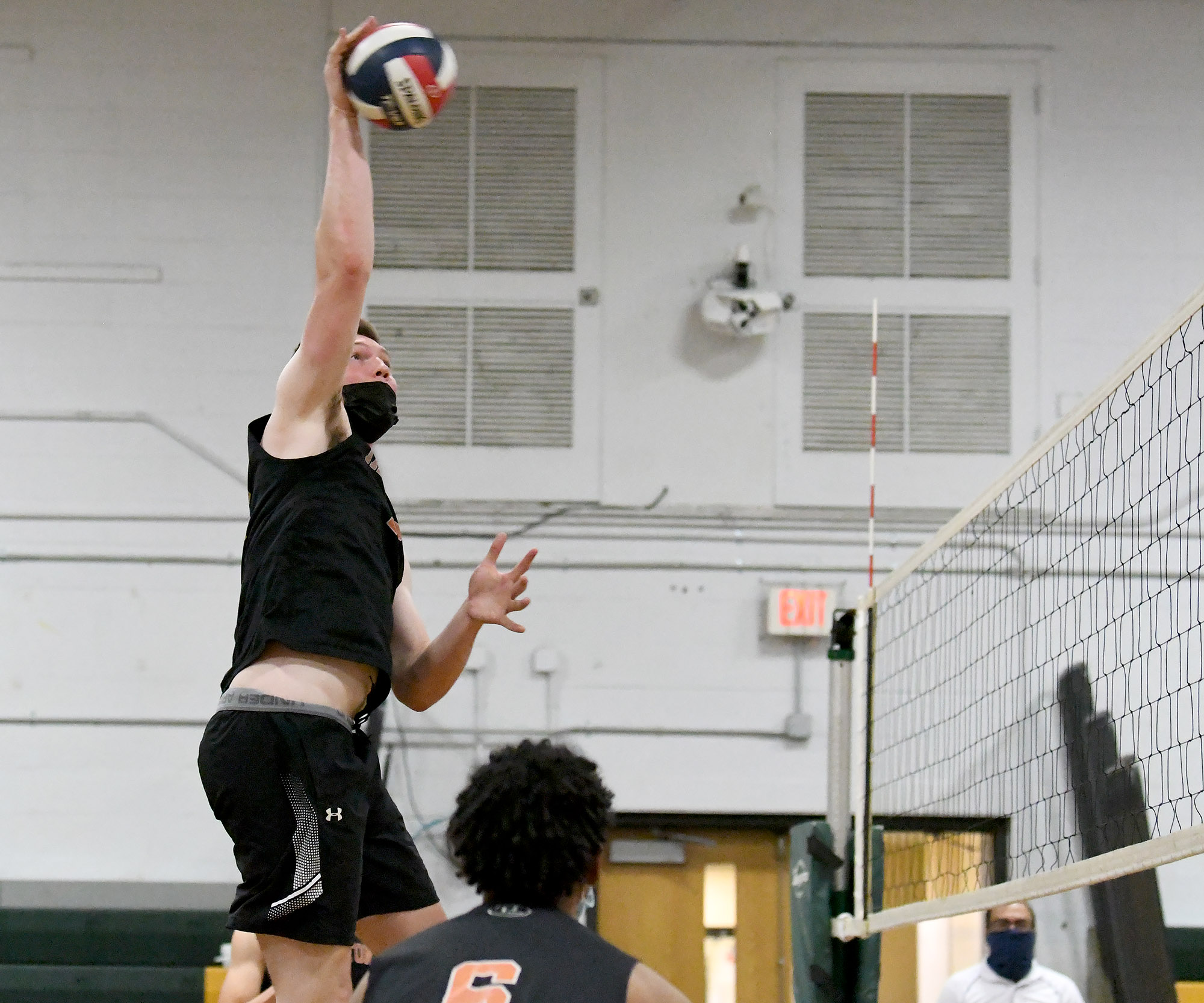 Tyler Stewart uses his length to deliver another winner for Taunton High during a recent match.