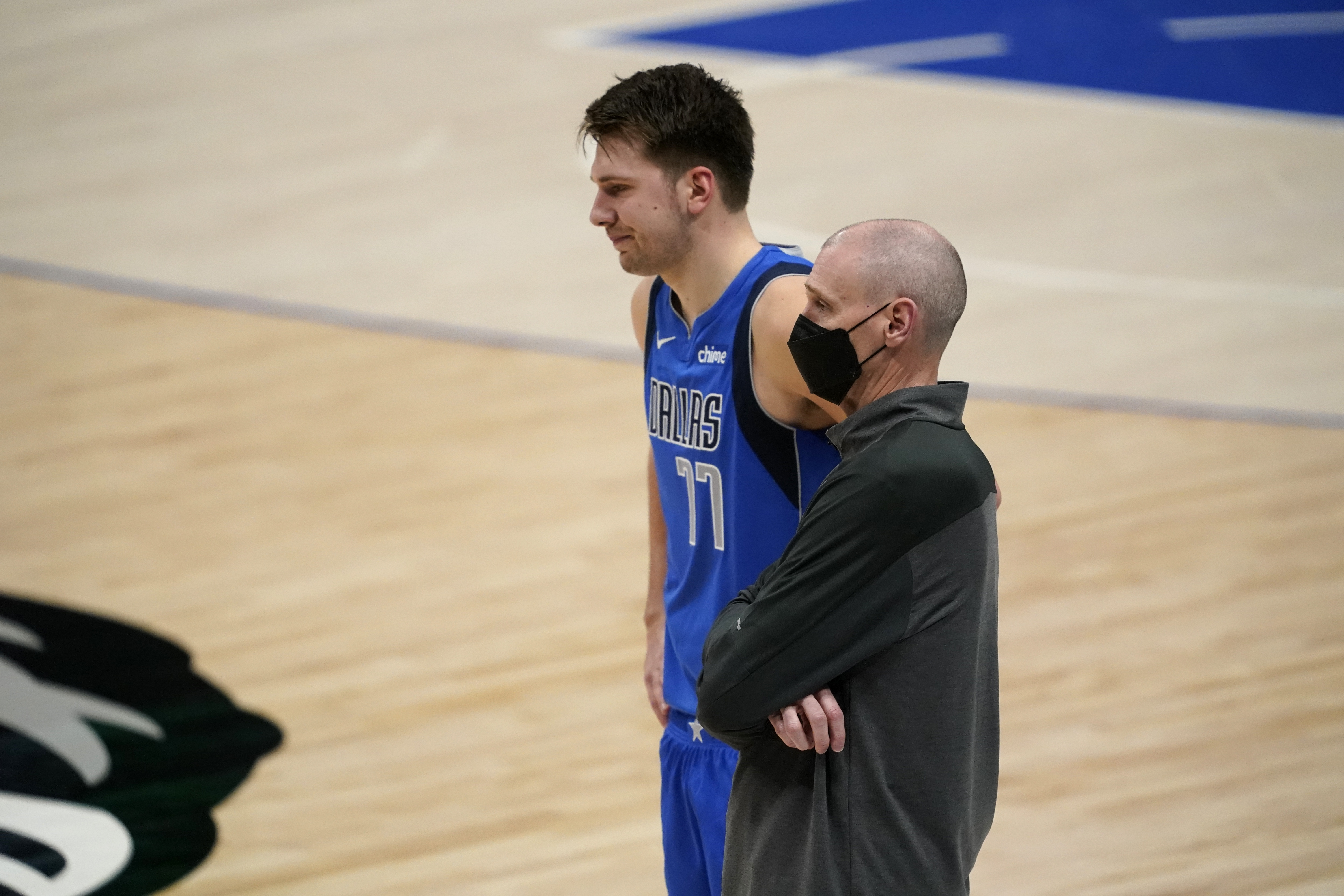 Rick Carlisle (right) stepped down after 13 years coaching the Mavericks, a job opening made tantalizing by star guard Luka Doncic (left).