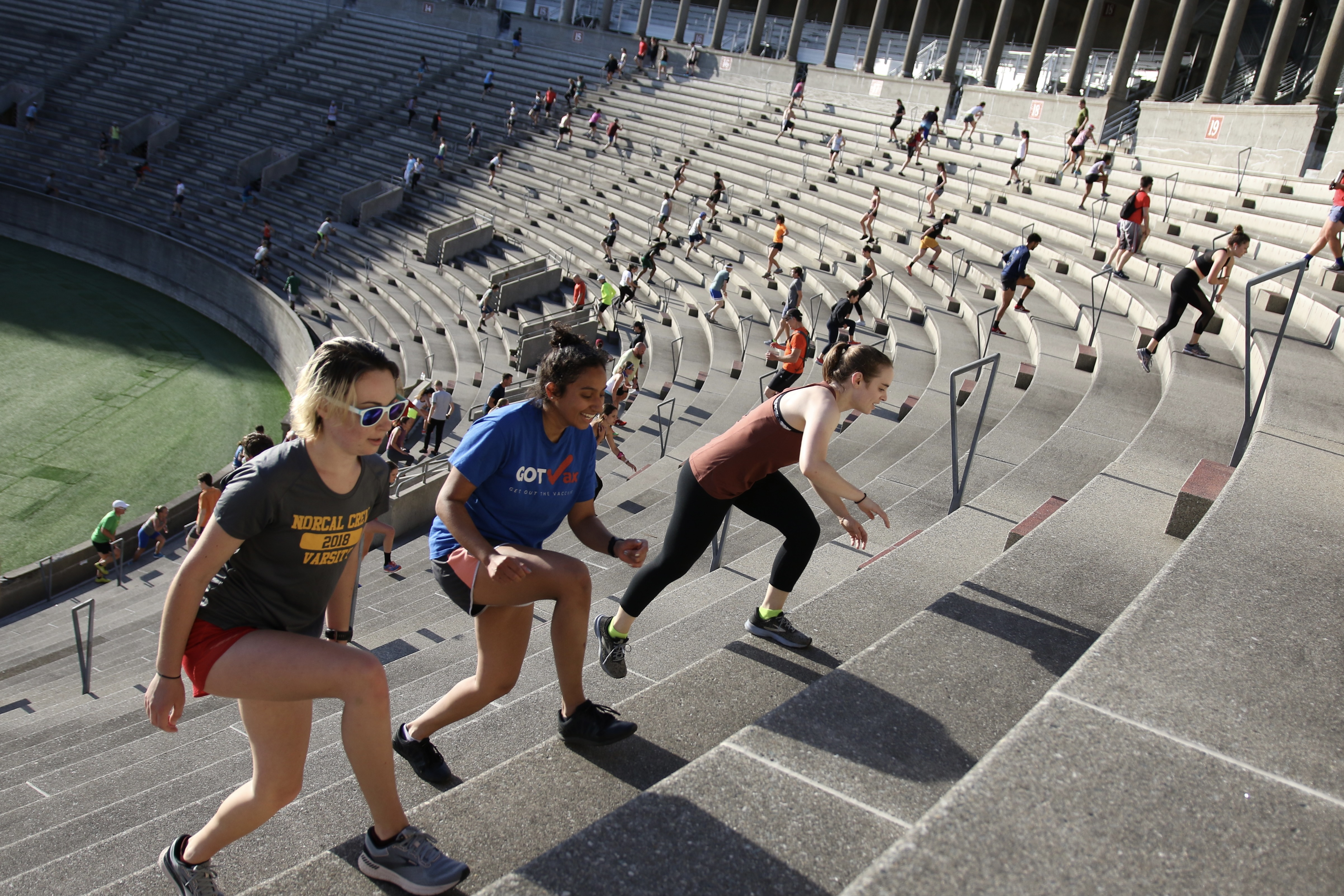 People climb the stairs at Harvard Stadium on June 23 as part of a weekly program hosted by the November Project.