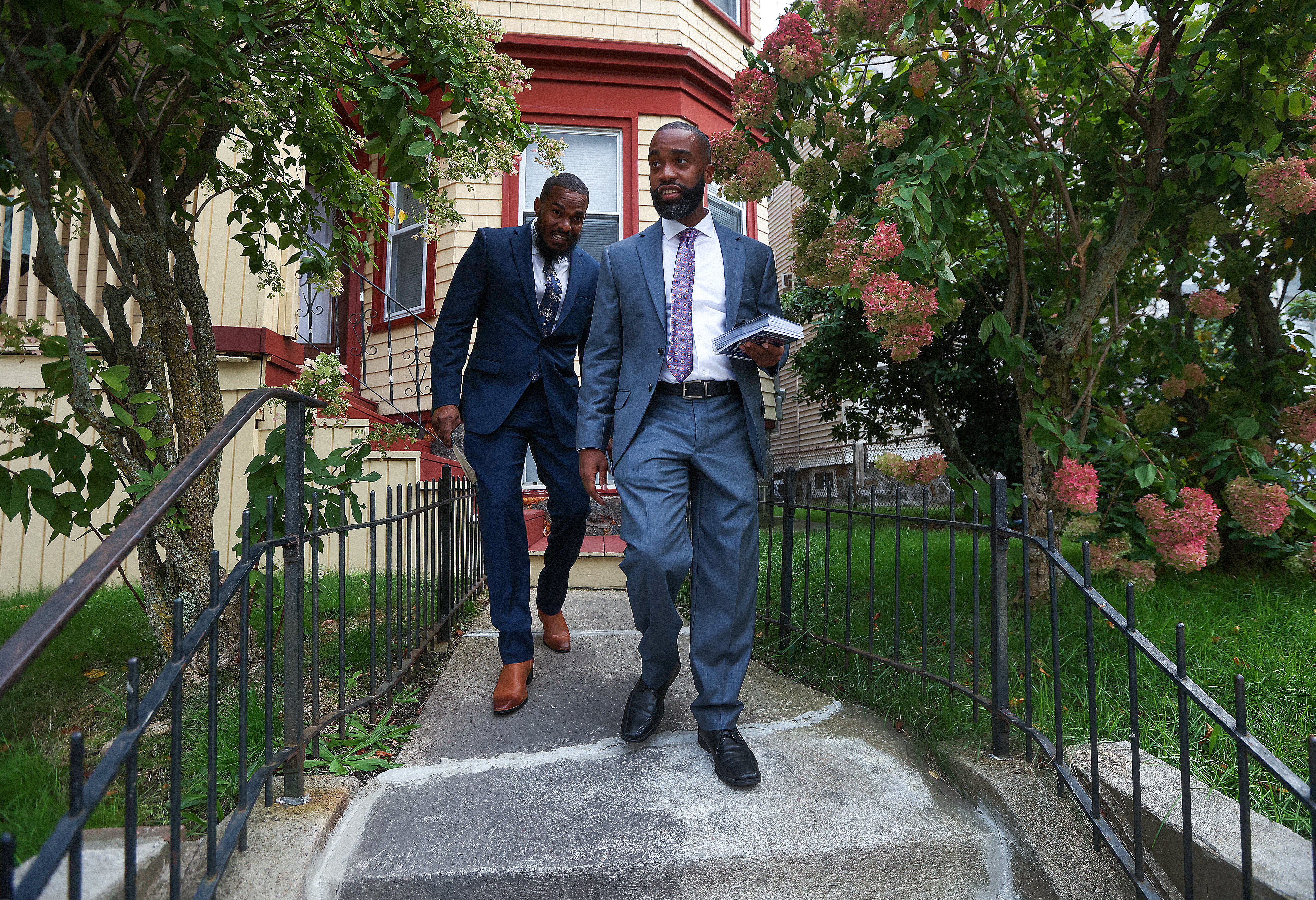 Brian Worrell, followed by campaign aide Chet Brown, knocked on Dorchester's doors.