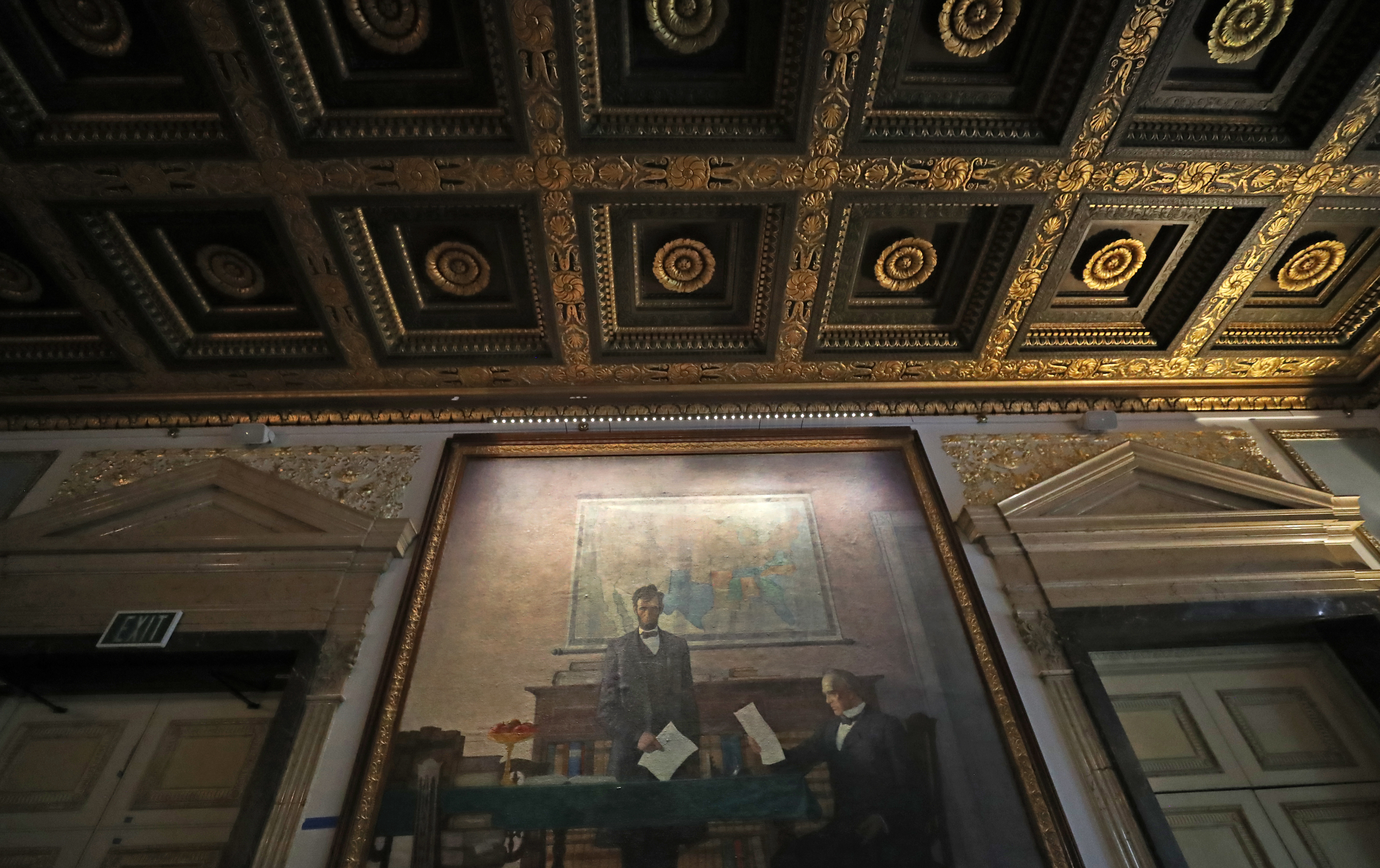 A mural by N.C. Wyeth of President Lincoln on the wall with detail of a gold leaf ceiling, both evocative of the building's history as the former Federal Reserve Bank of Boston.