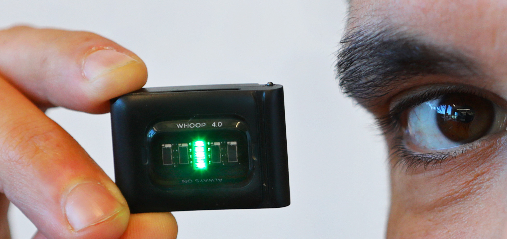 Will Ahmed is founder and CEO of WHOOP, a fitness wearable company. He holds the new WHOOP 4.0 sensor.