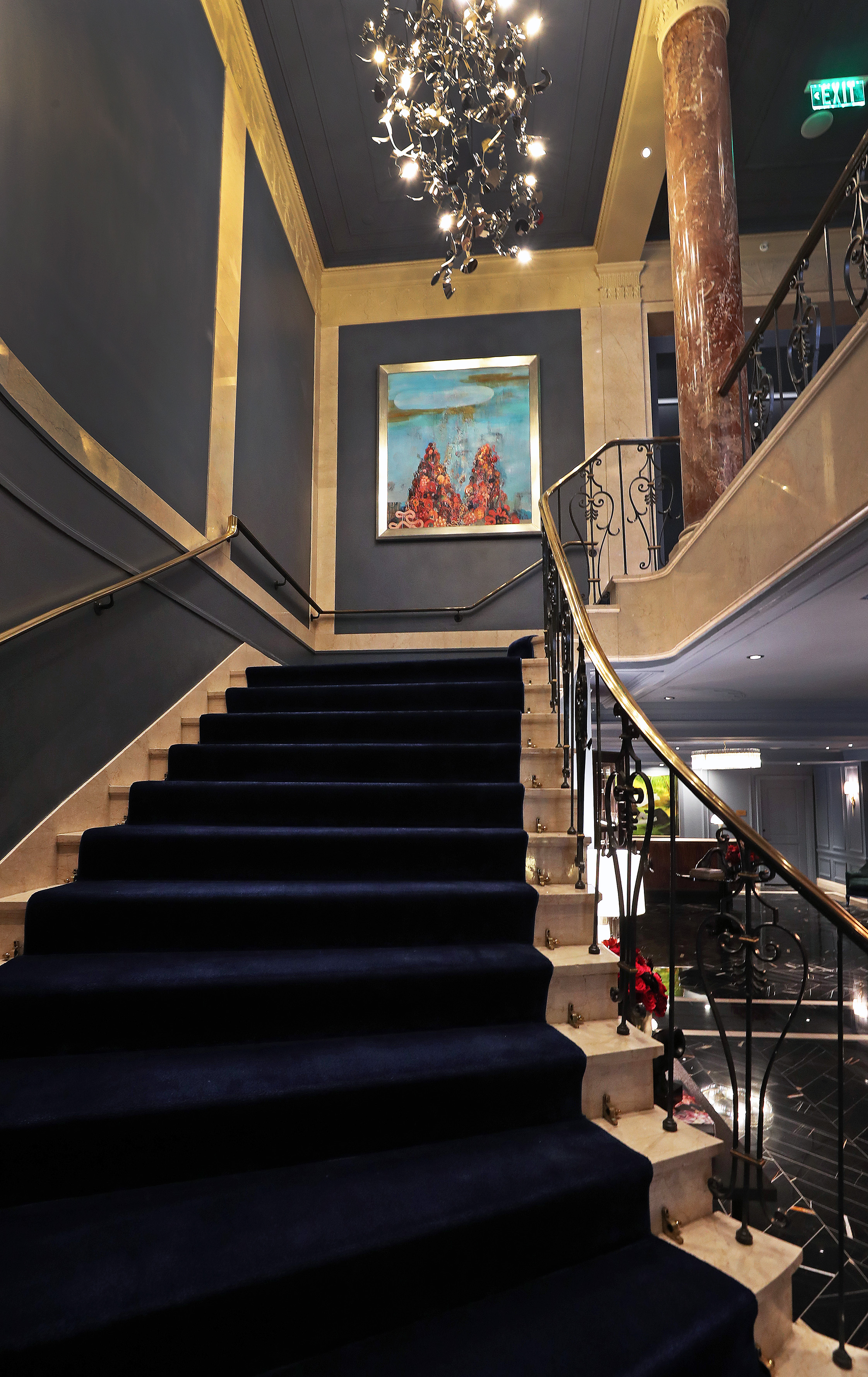 The staircase leading from the first floor lobby to the second floor.