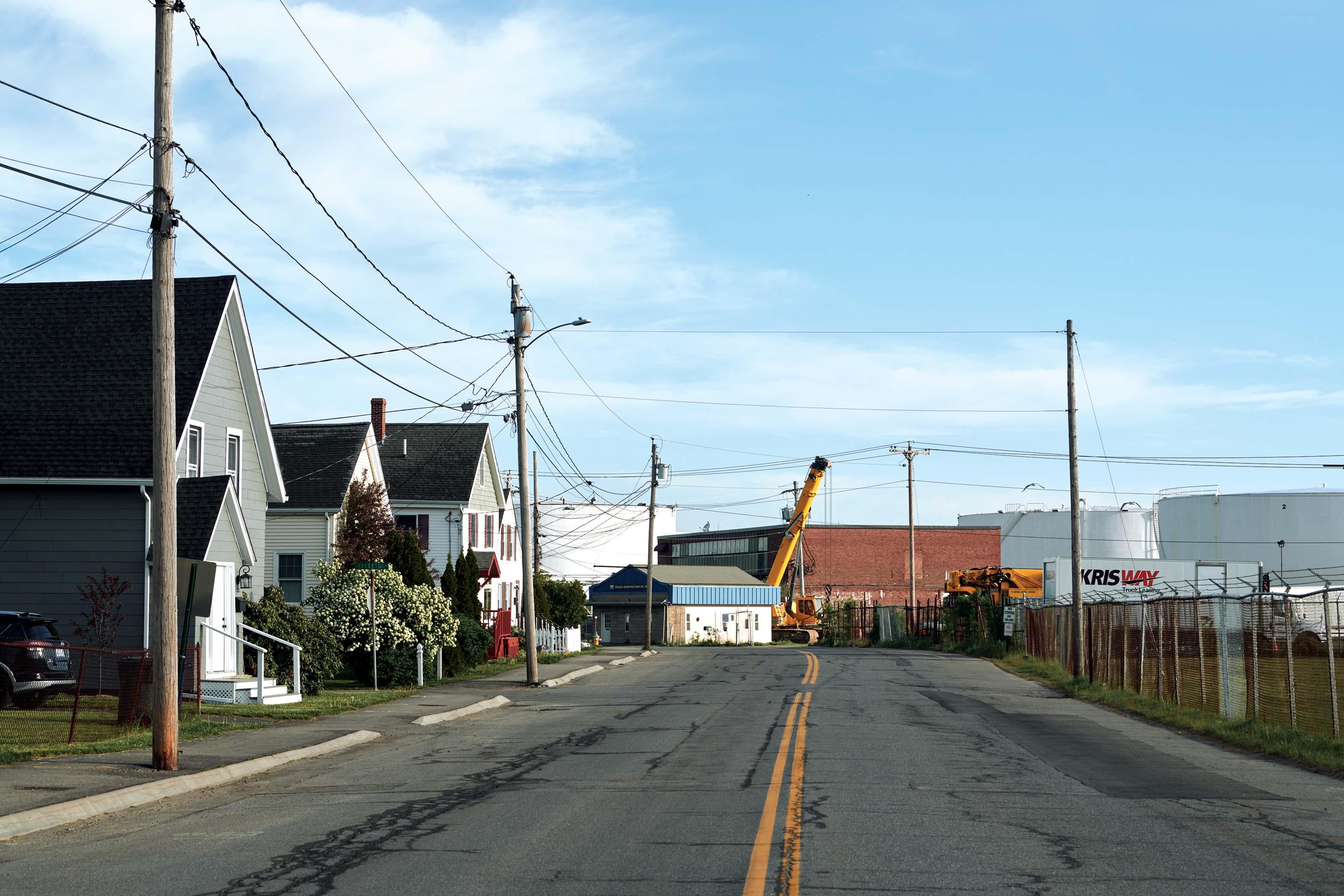 Petroleum storage tanks sit alongside a residential neighborhood in South Portland.