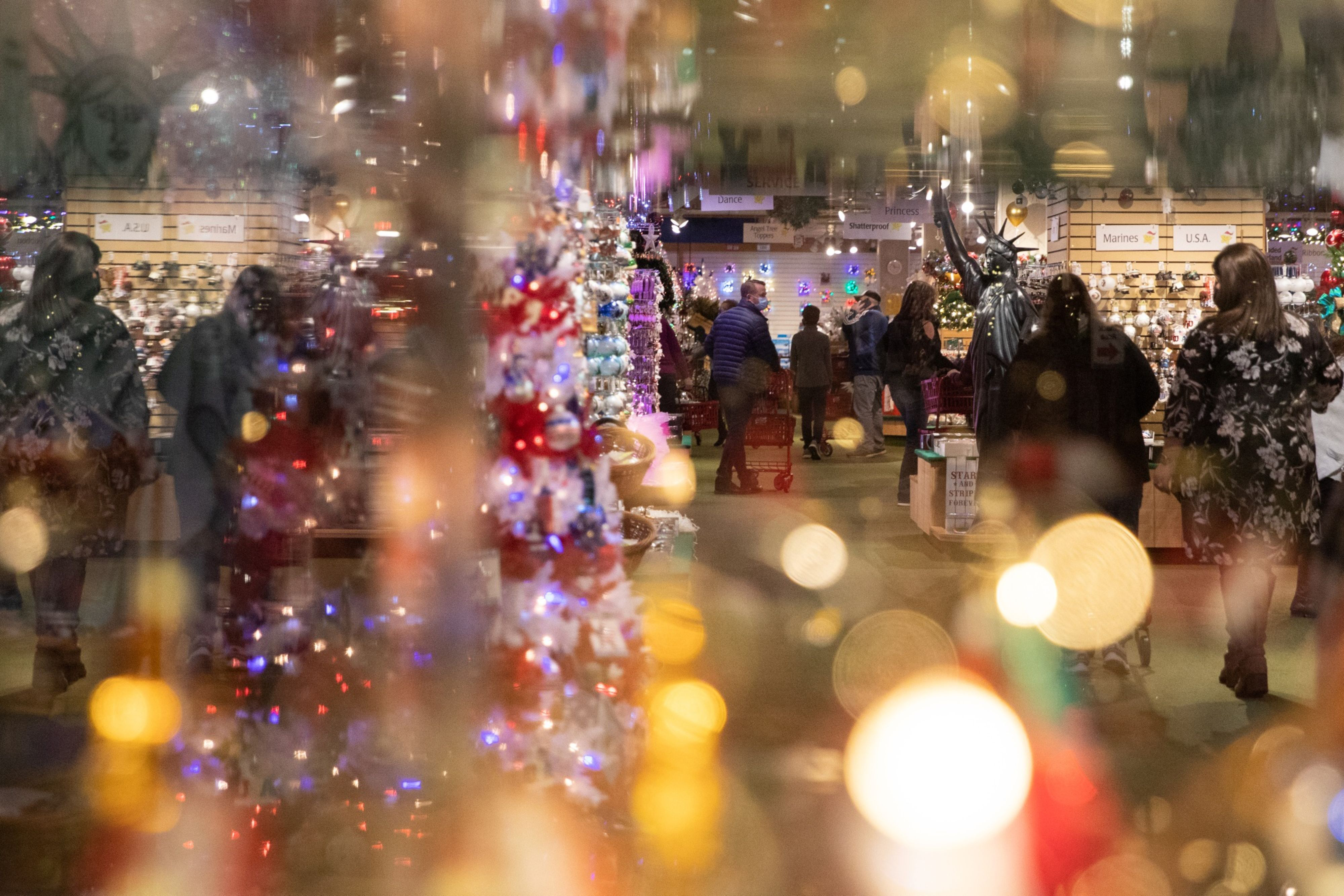 Customers wore protective masks as they shopped for holiday decorations at Bronner's Christmas Wonderland store in Frankenmuth, Mich., in December.