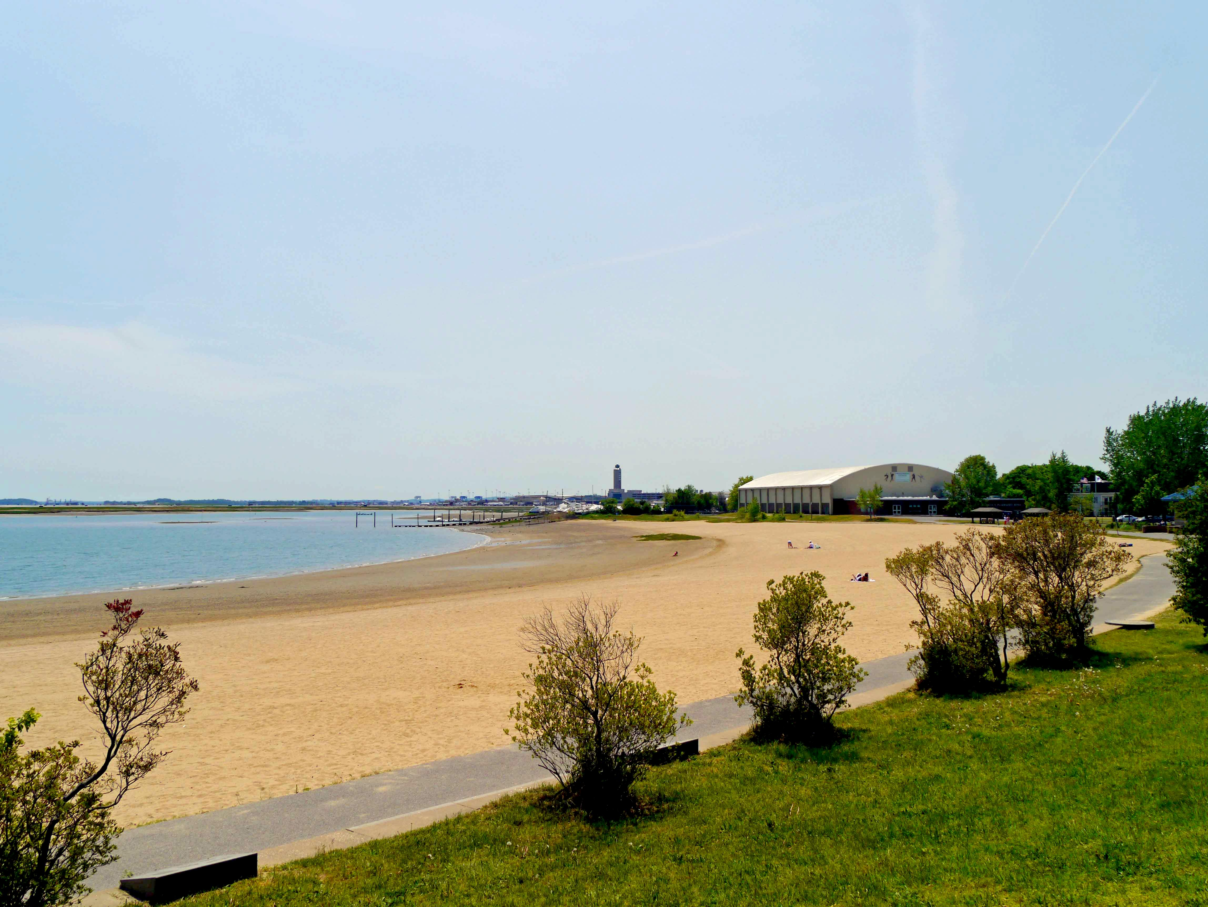 The sandy crescent of Constitution Beach is complemented by a playground, public baths, playgrounds, and picnic tables.